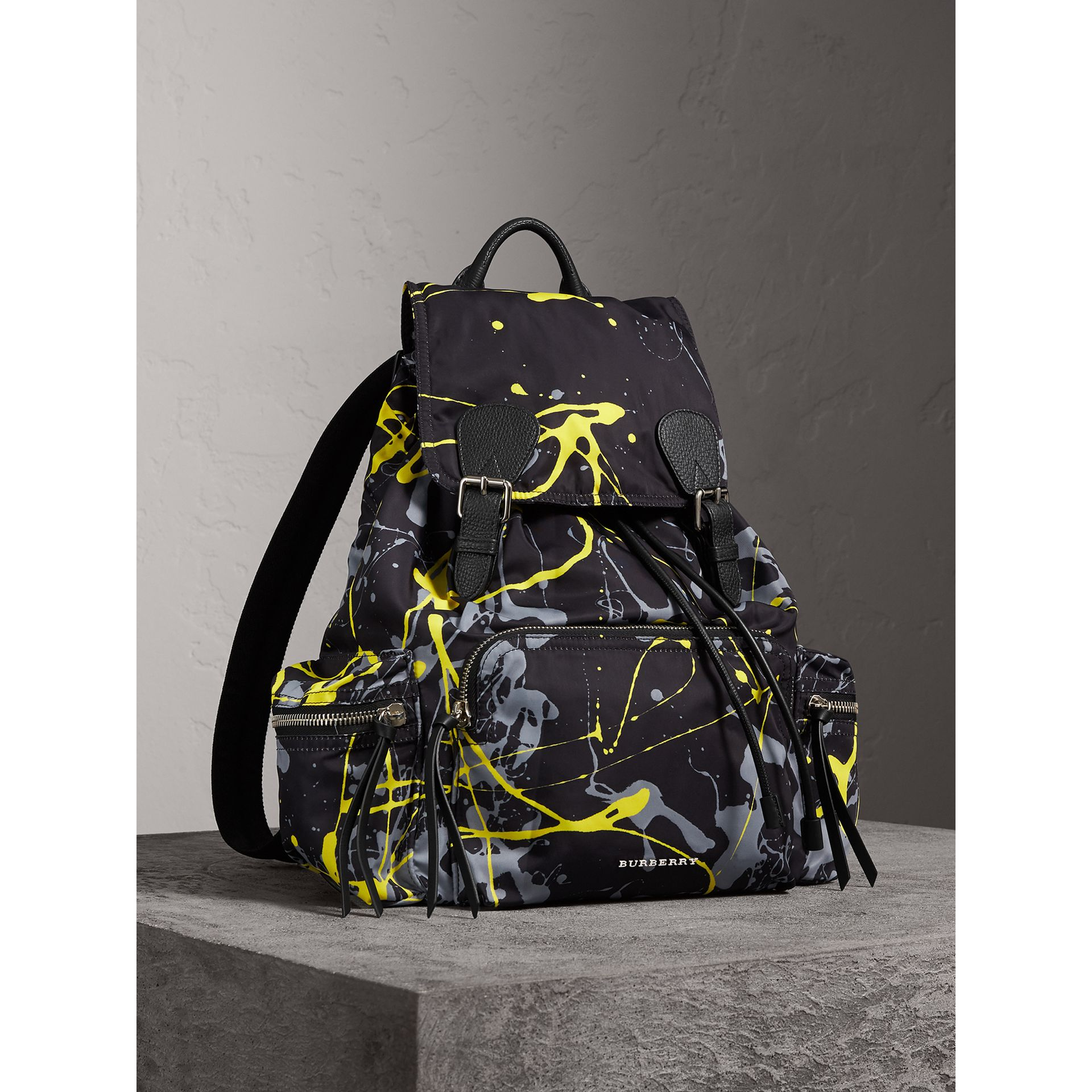 The Large Rucksack in Splash Print in Black/yellow - Men | Burberry United Kingdom - gallery image 0