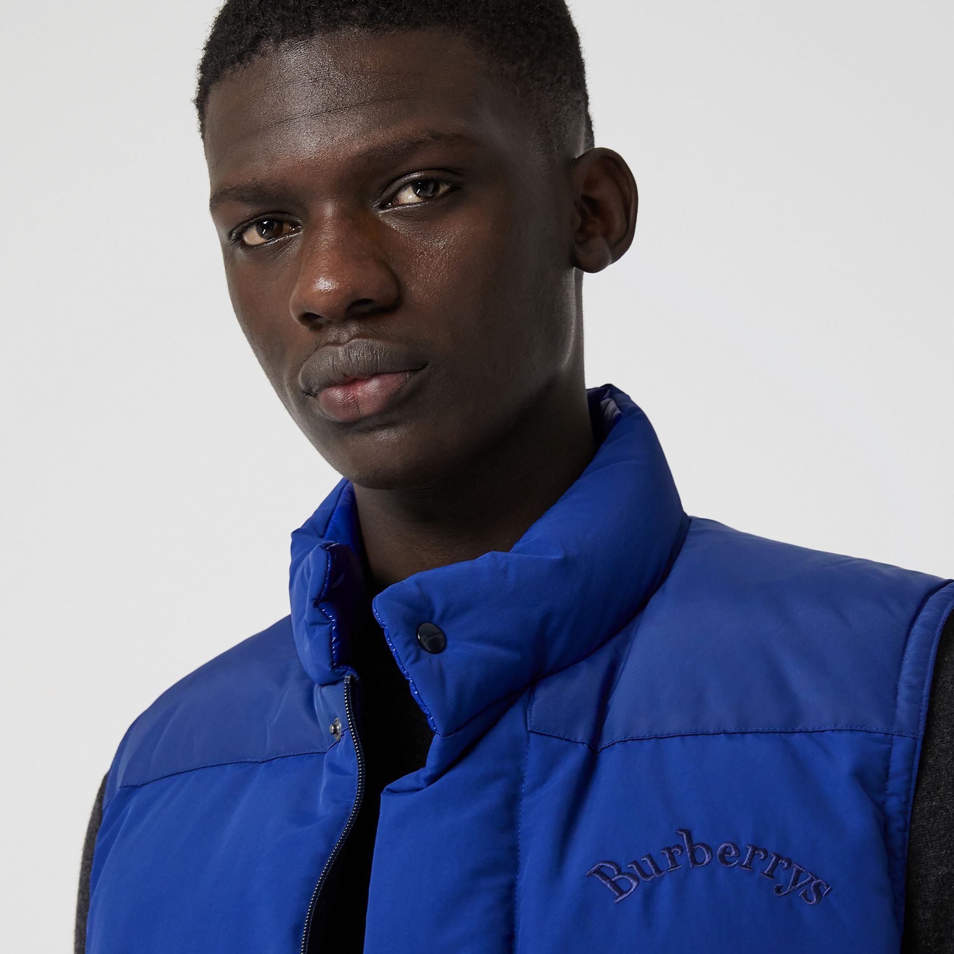 Embroidered Archive Logo Down-filled Gilet in Bright Blue - Men | Burberry - gallery image 1