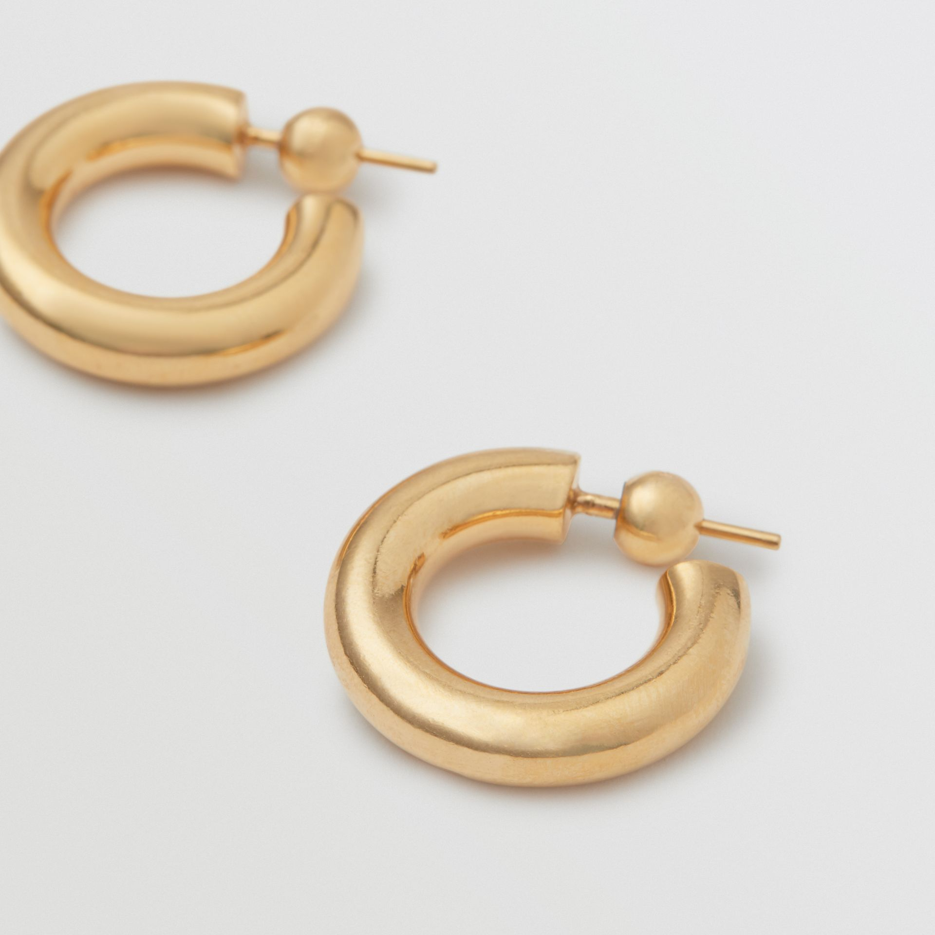 Gold-plated Hoop Earrings in Light - Women | Burberry Australia - gallery image 1
