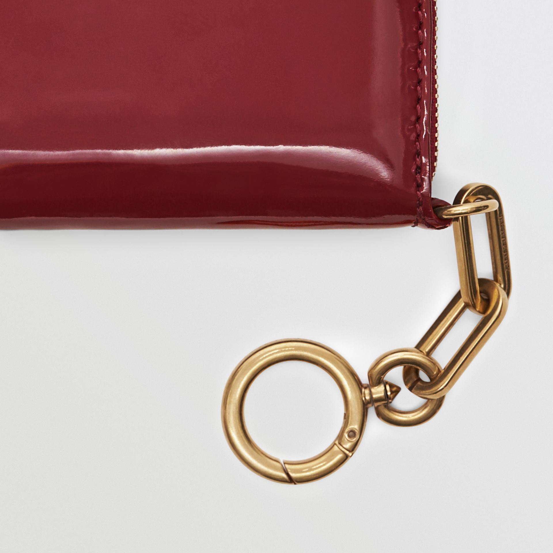 Link Detail Patent Leather Ziparound Wallet in Crimson - Women | Burberry Canada - gallery image 1