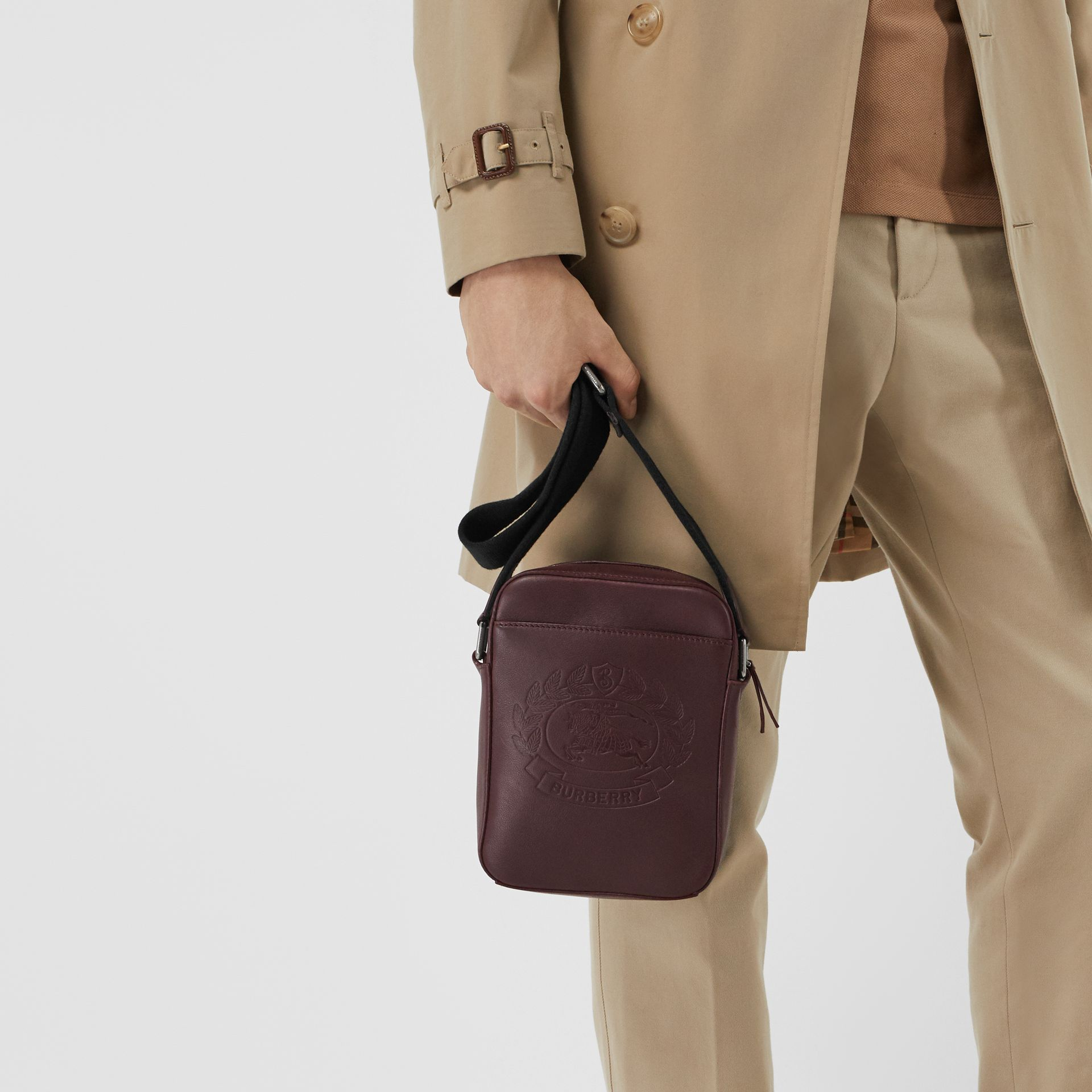 Small Embossed Crest Leather Crossbody Bag in Oxblood - Men | Burberry - gallery image 3