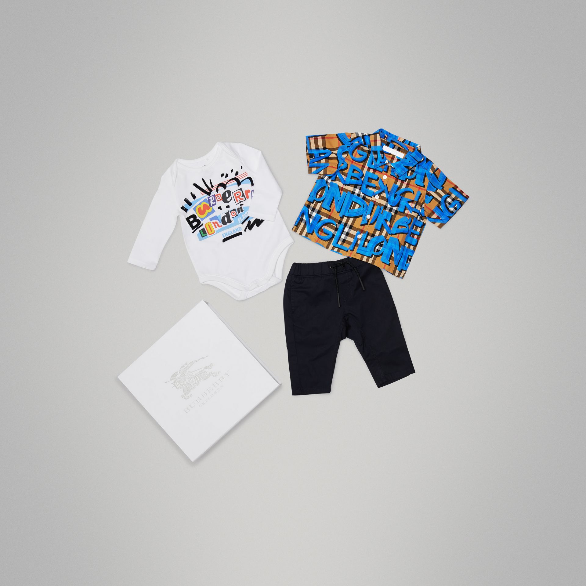 Graffiti Print Cotton Three-piece Baby Gift Set in Bright Blue - Children | Burberry - gallery image 0