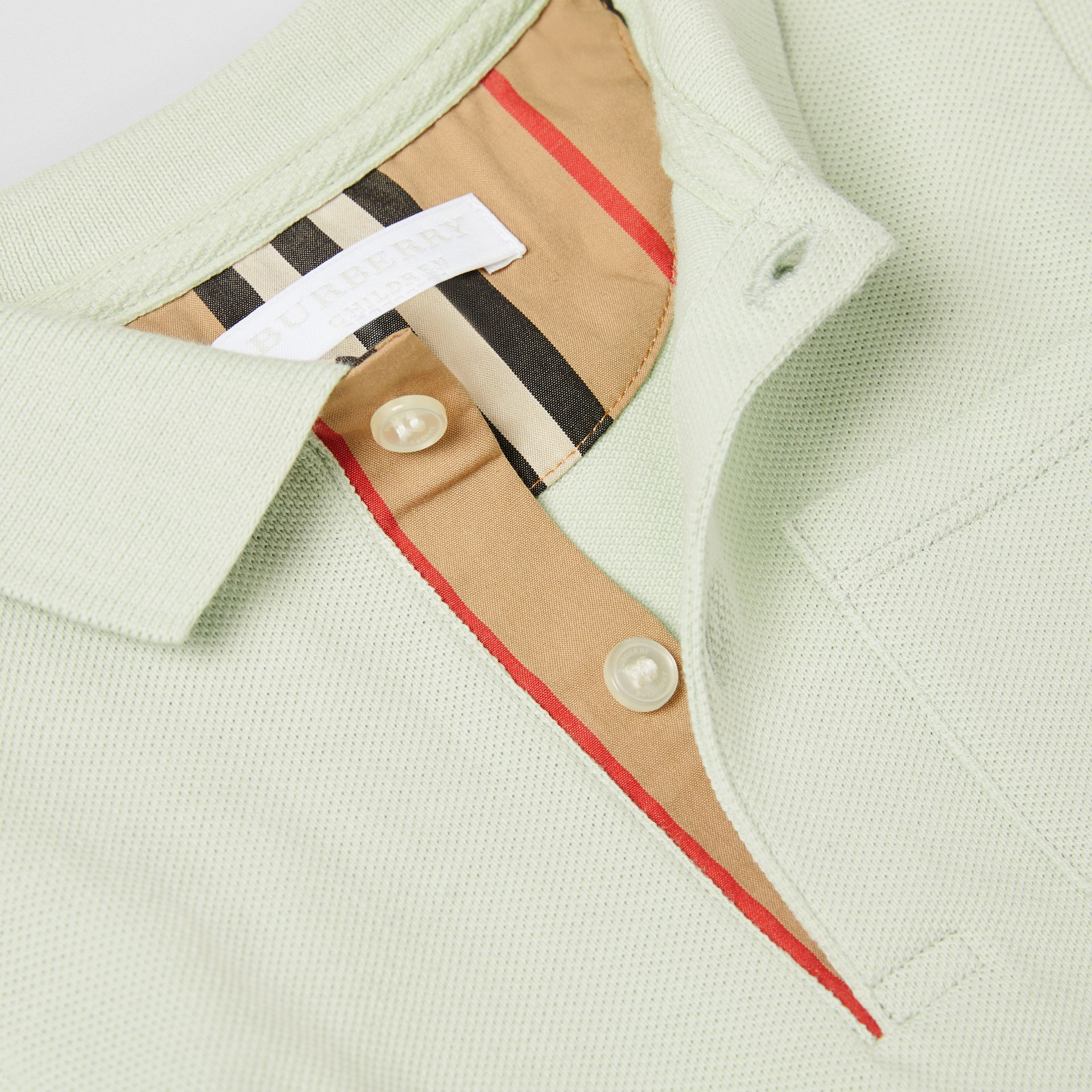 Icon Stripe Placket Cotton Piqué Polo Shirt in Pale Mint - Children | Burberry - gallery image 1