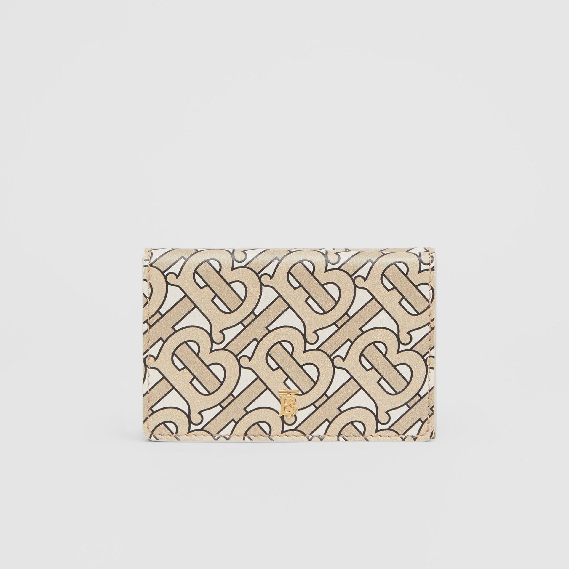Small Monogram Print Leather Folding Wallet in Beige - Women | Burberry - gallery image 0