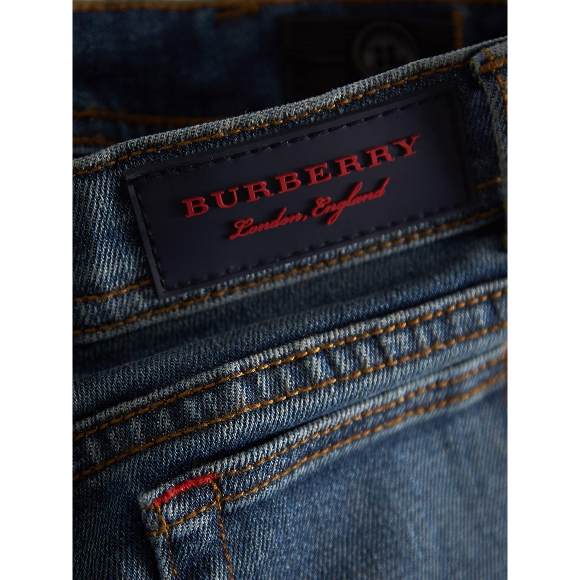 Relaxed Fit Stretch Denim Jeans in Mid Indigo - Girl | Burberry United Kingdom - gallery image 1