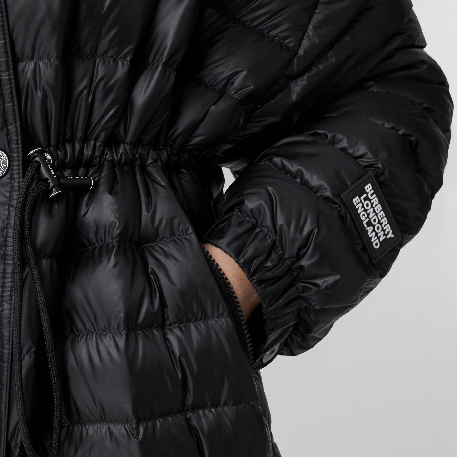Logo Tape Lightweight Hooded Puffer Coat in Black - Women | Burberry United Kingdom - gallery image 1