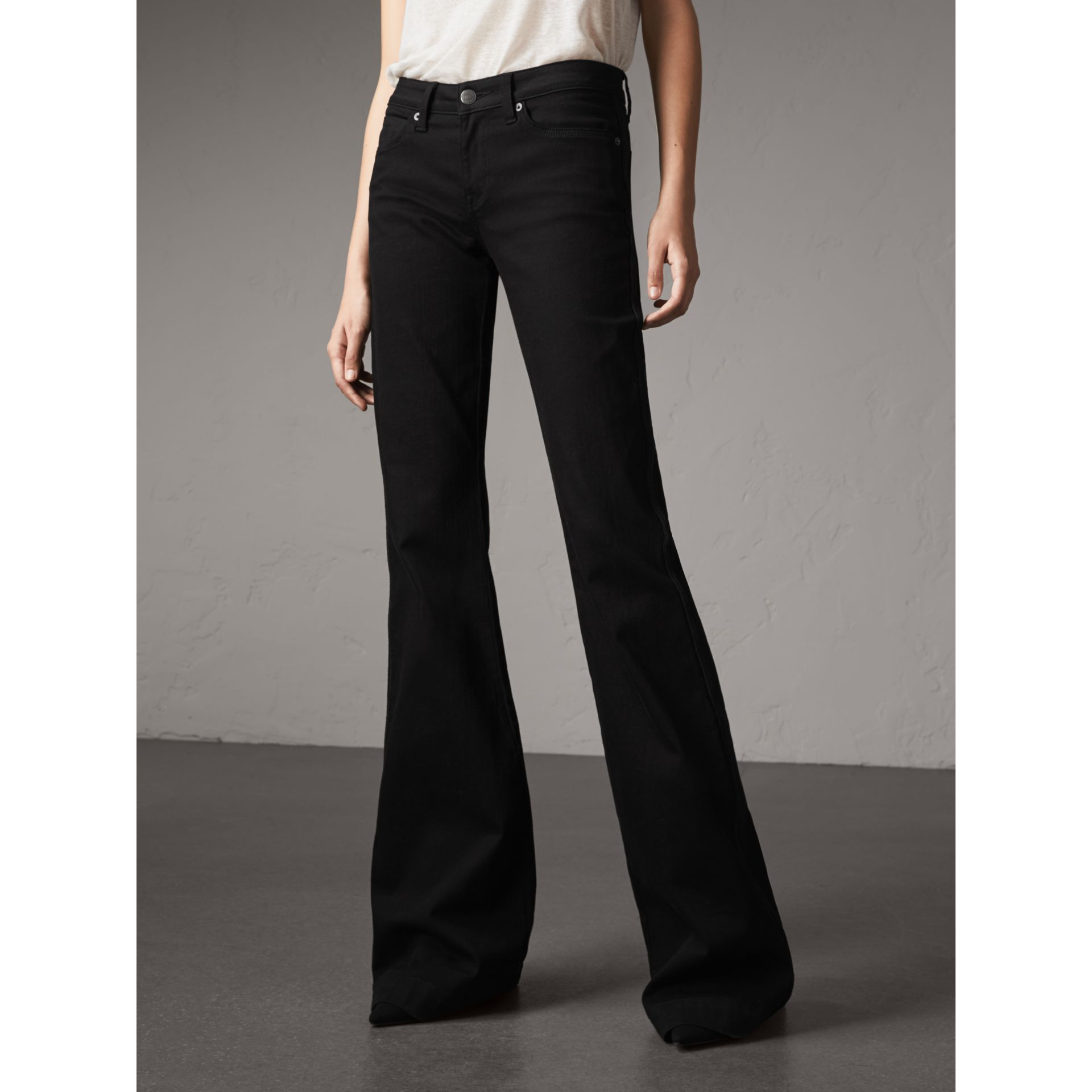 Flared Stretch Jeans in Black - Women | Burberry Canada - gallery image 4