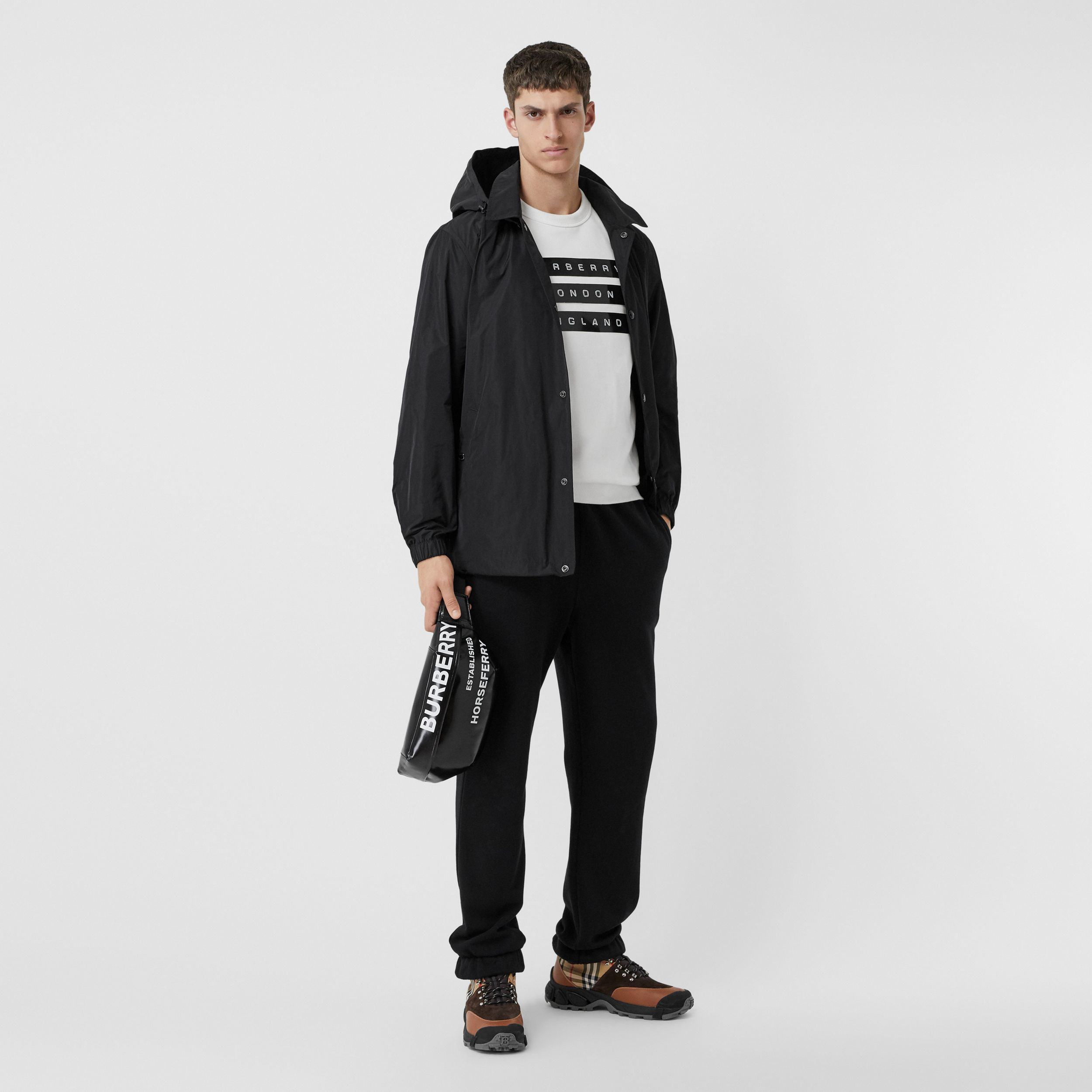 Detachable Hood Logo Graphic Lightweight Jacket in Black - Men | Burberry - 1