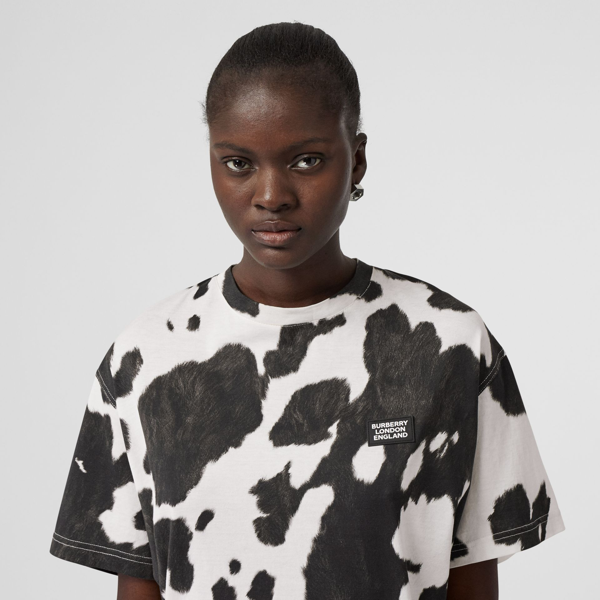 Logo Detail Cow Print Cotton Oversized T-shirt in Black - Women | Burberry - gallery image 1