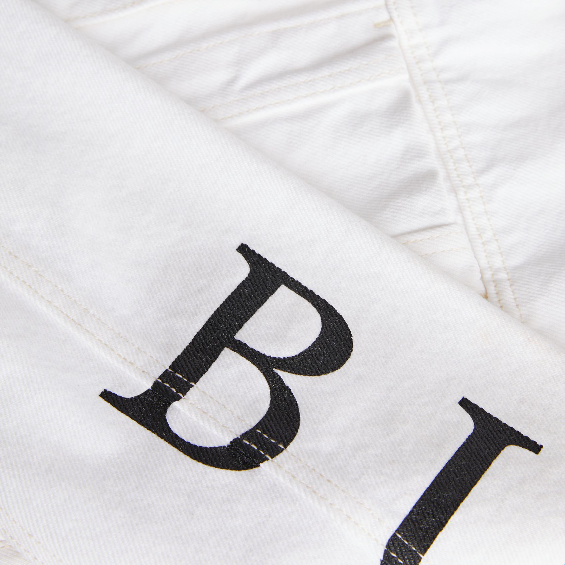 Logo Print Denim Jacket in Natural White | Burberry - gallery image 1