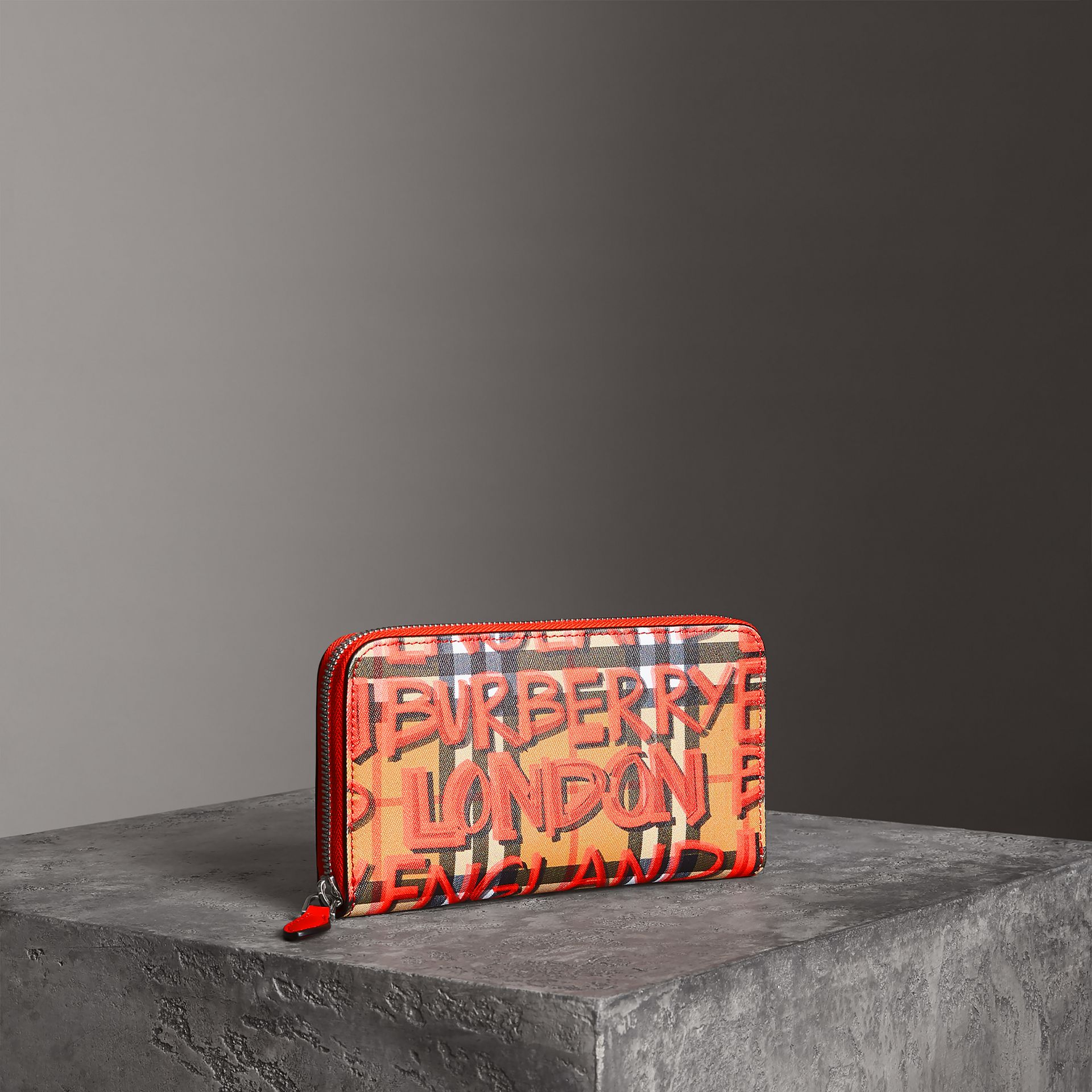 Graffiti Print Vintage Check Leather Ziparound Wallet in Red - Women | Burberry United Kingdom - gallery image 0