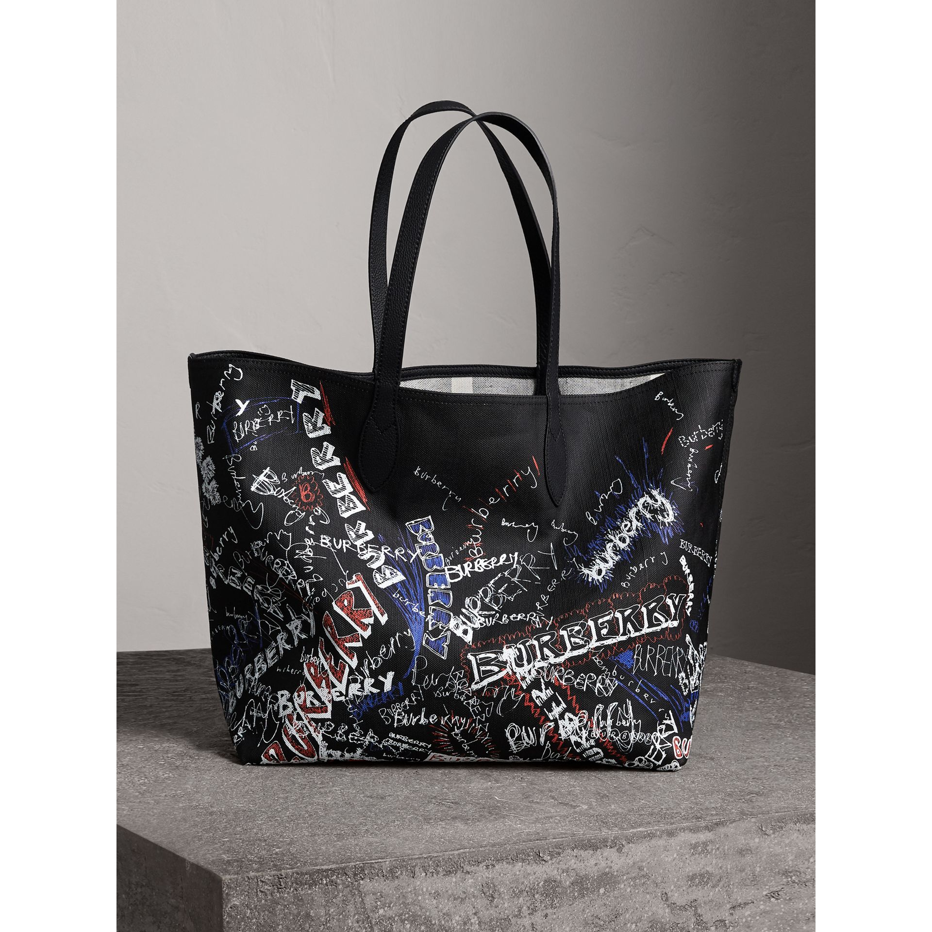 The Large Reversible Doodle Tote in Black | Burberry - gallery image 1