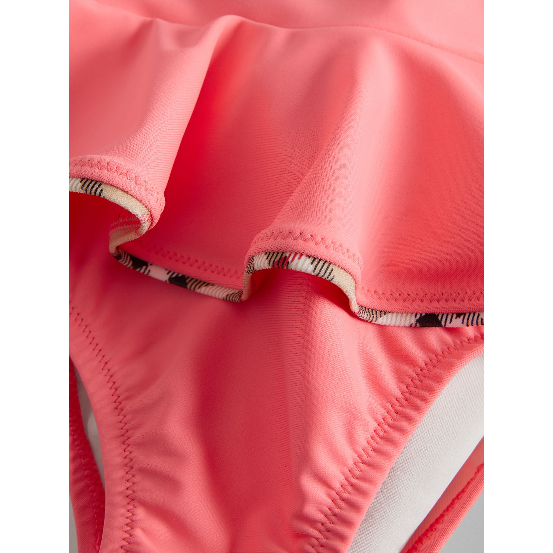Ruffle Detail One-piece Swimsuit in Bright Coral - Children | Burberry United Kingdom - gallery image 1