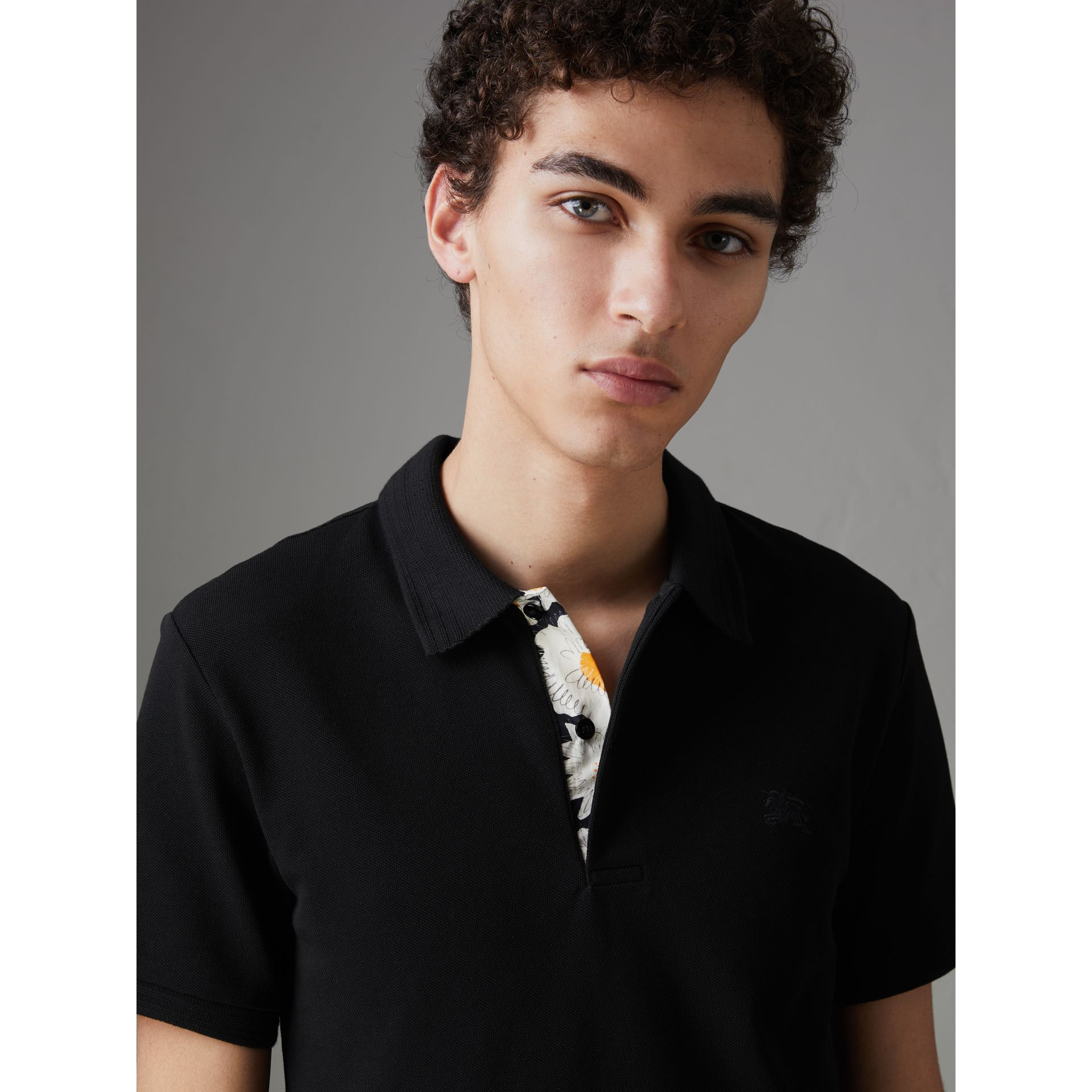 Daisy Print Trim Cotton Piqué Polo Shirt in Black - Men | Burberry - gallery image 1