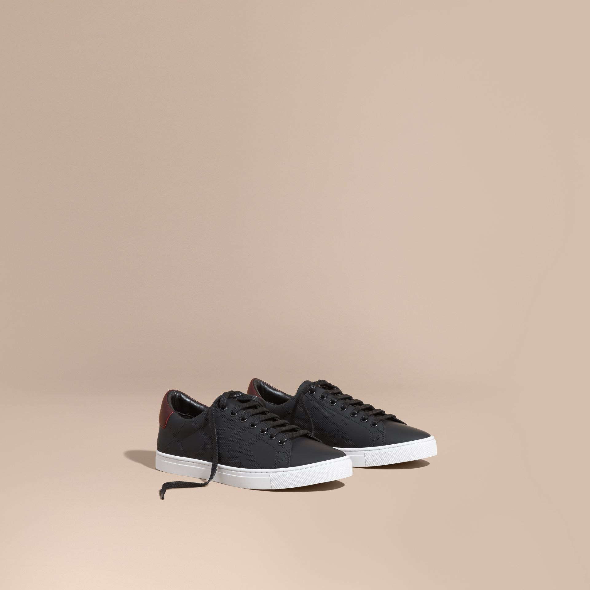Perforated Check Leather Trainers in Black/deep Claret Melange - Men | Burberry - gallery image 0