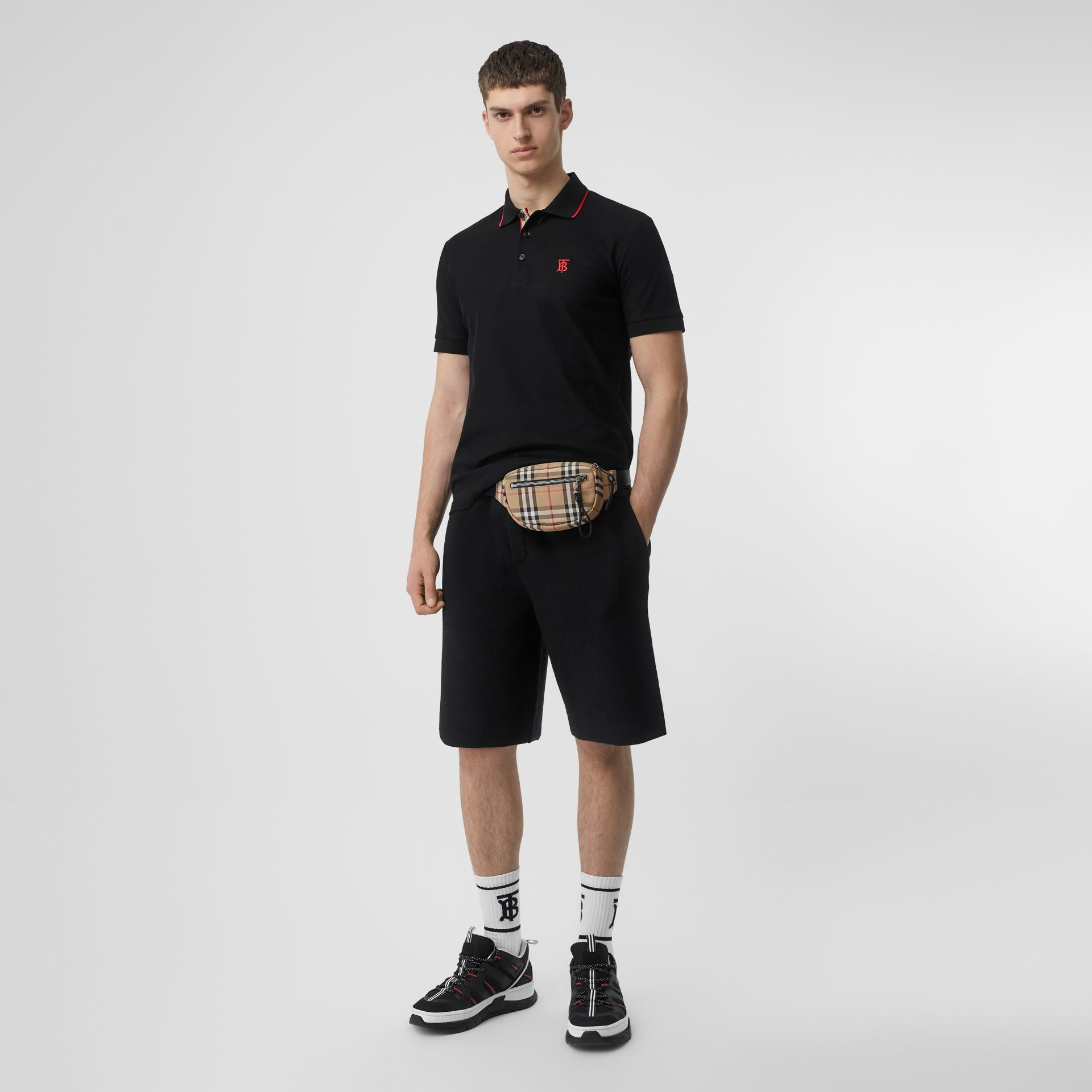 Icon Stripe Placket Cotton Piqué Polo Shirt in Black - Men | Burberry Canada - gallery image 0