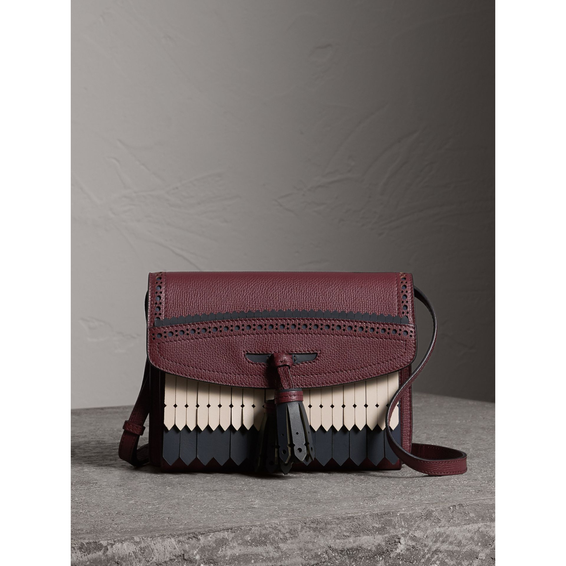 Brogue and Fringe Detail Leather Crossbody Bag in Mahogany Red - Women | Burberry - gallery image 1