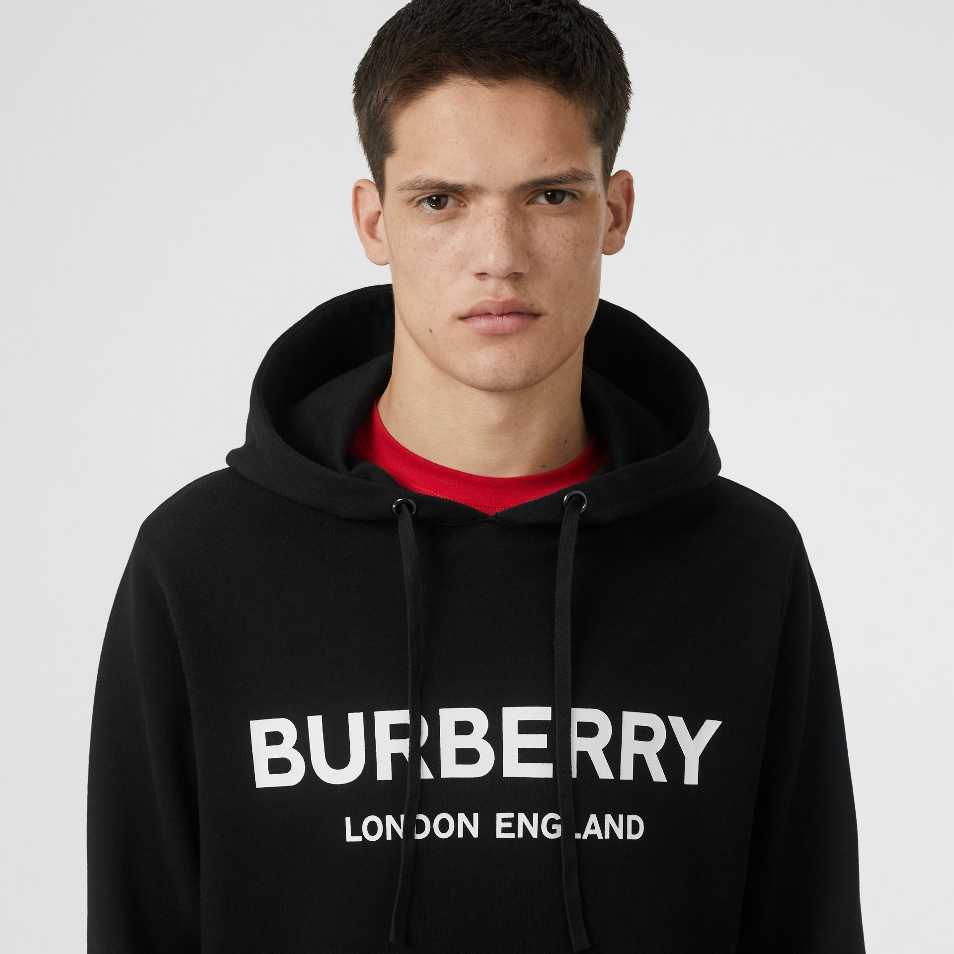 Logo Print Cotton Hoodie in Black - Men | Burberry United Kingdom - gallery image 1