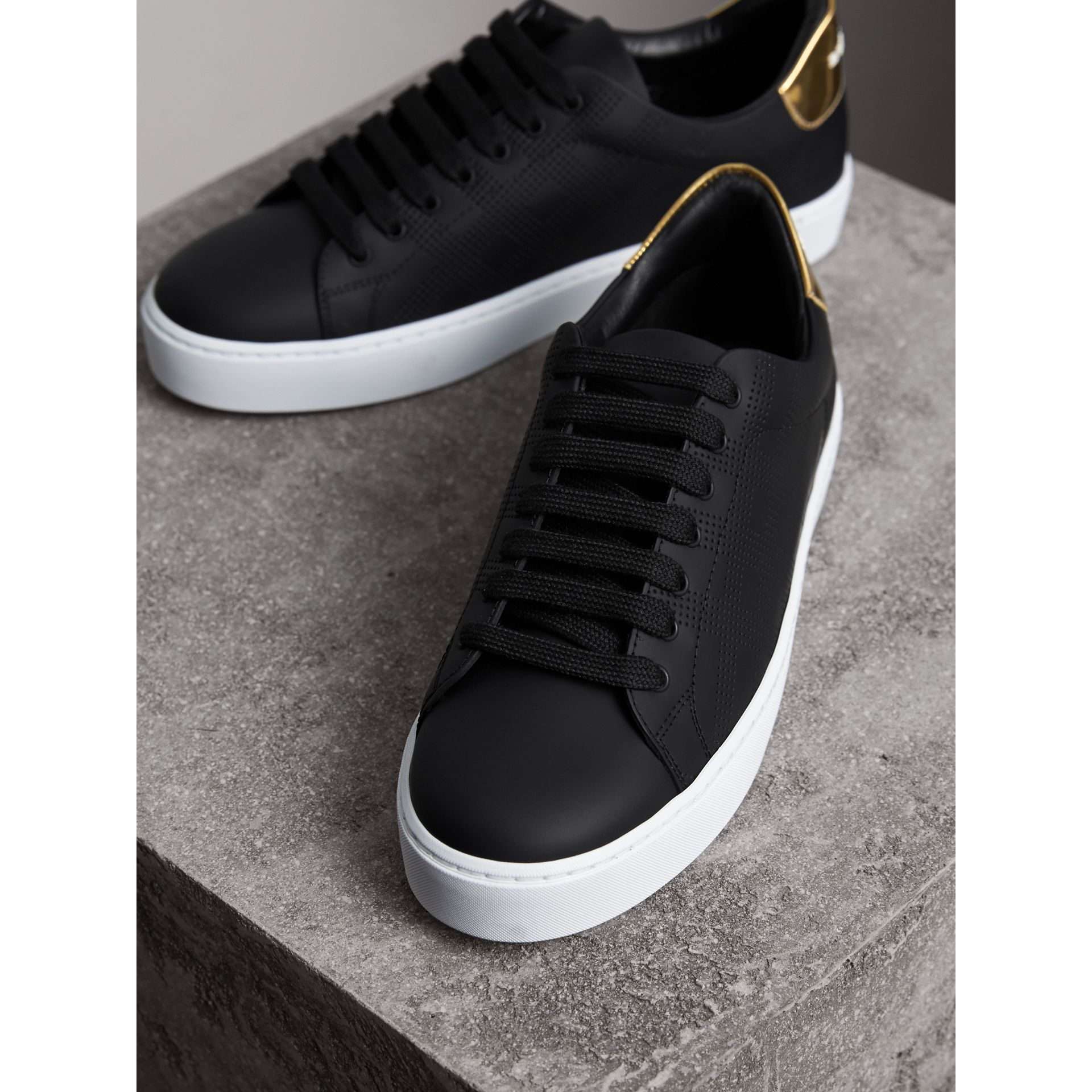 Perforated Check Leather Trainers in Black - Women | Burberry - gallery image 3