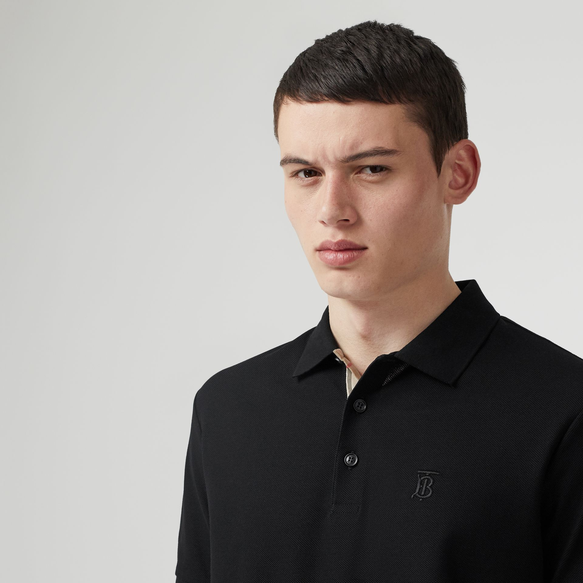 Monogram Motif Cotton Piqué Polo Shirt in Black - Men | Burberry United Kingdom - gallery image 1