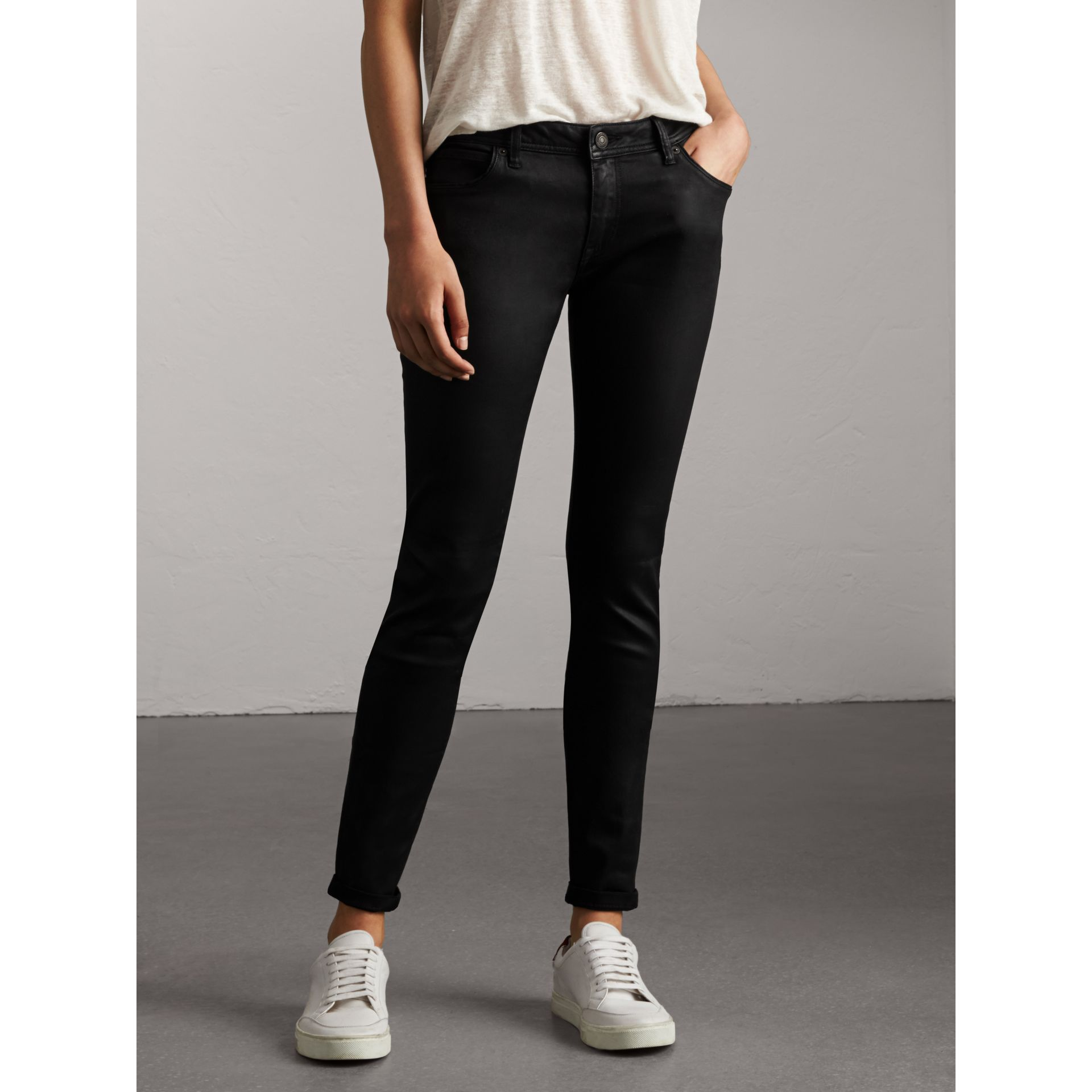 Skinny Fit Low-rise Wax Coated Jeans in Black - Women | Burberry Canada - gallery image 1
