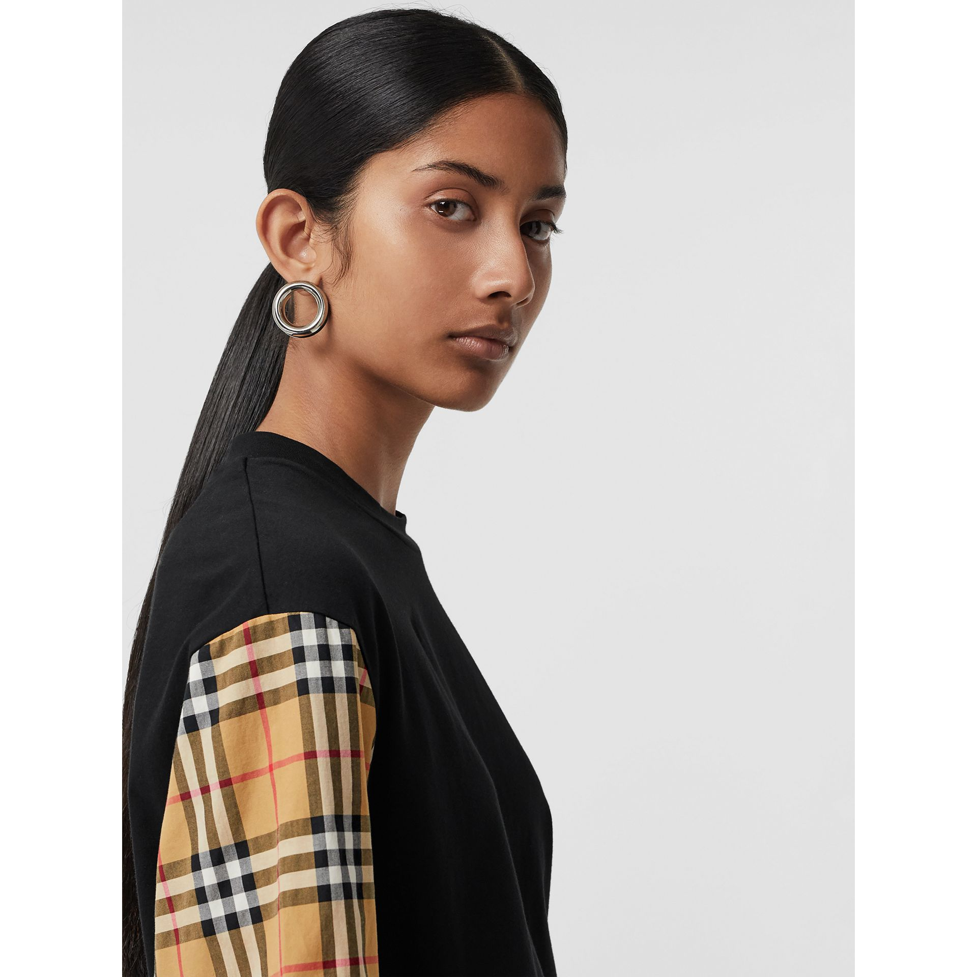 Vintage Check-sleeve Cotton Oversized T-shirt in Black - Women | Burberry Canada - gallery image 1