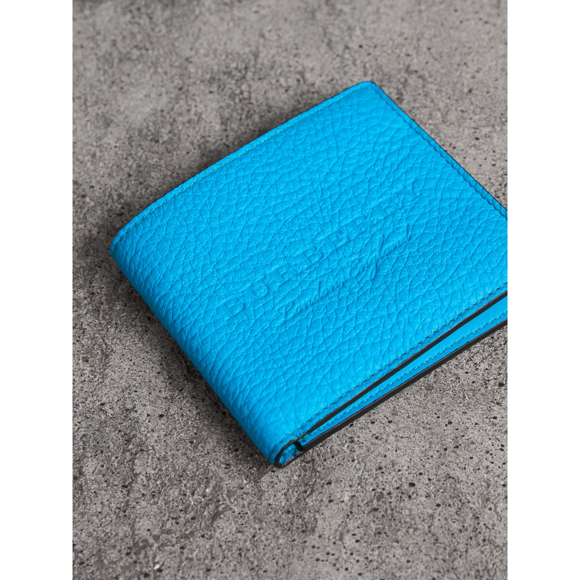 Embossed Leather International Bifold Wallet in Neon Blue - Men | Burberry United Kingdom - gallery image 1