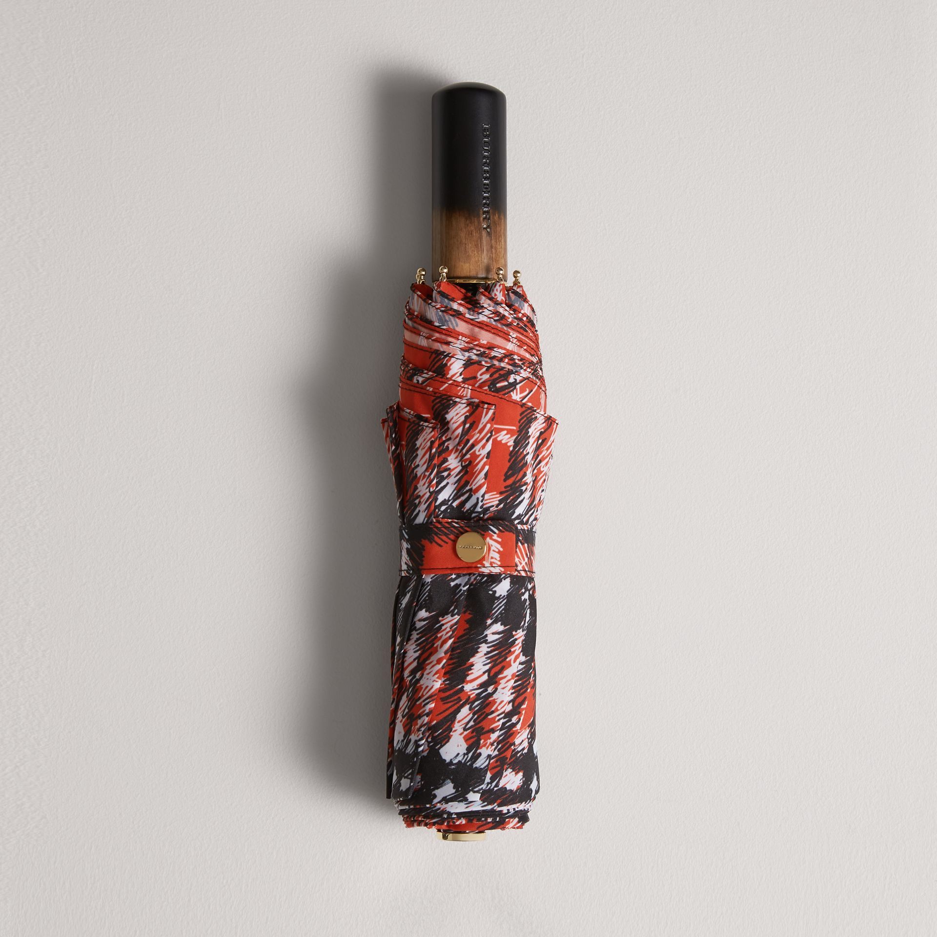 Scribble Check Print Folding Umbrella in Red | Burberry - gallery image 0