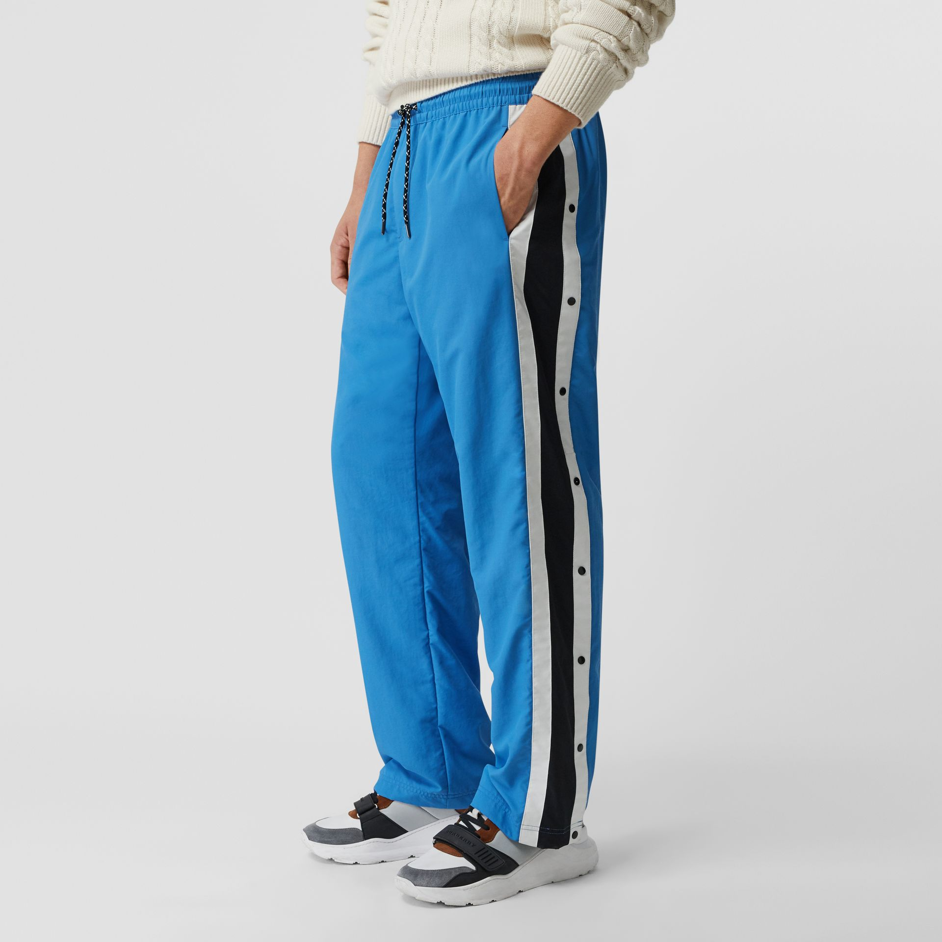 Varsity Stripe Jersey Trackpants in Bright Hydrangea - Men | Burberry - gallery image 4
