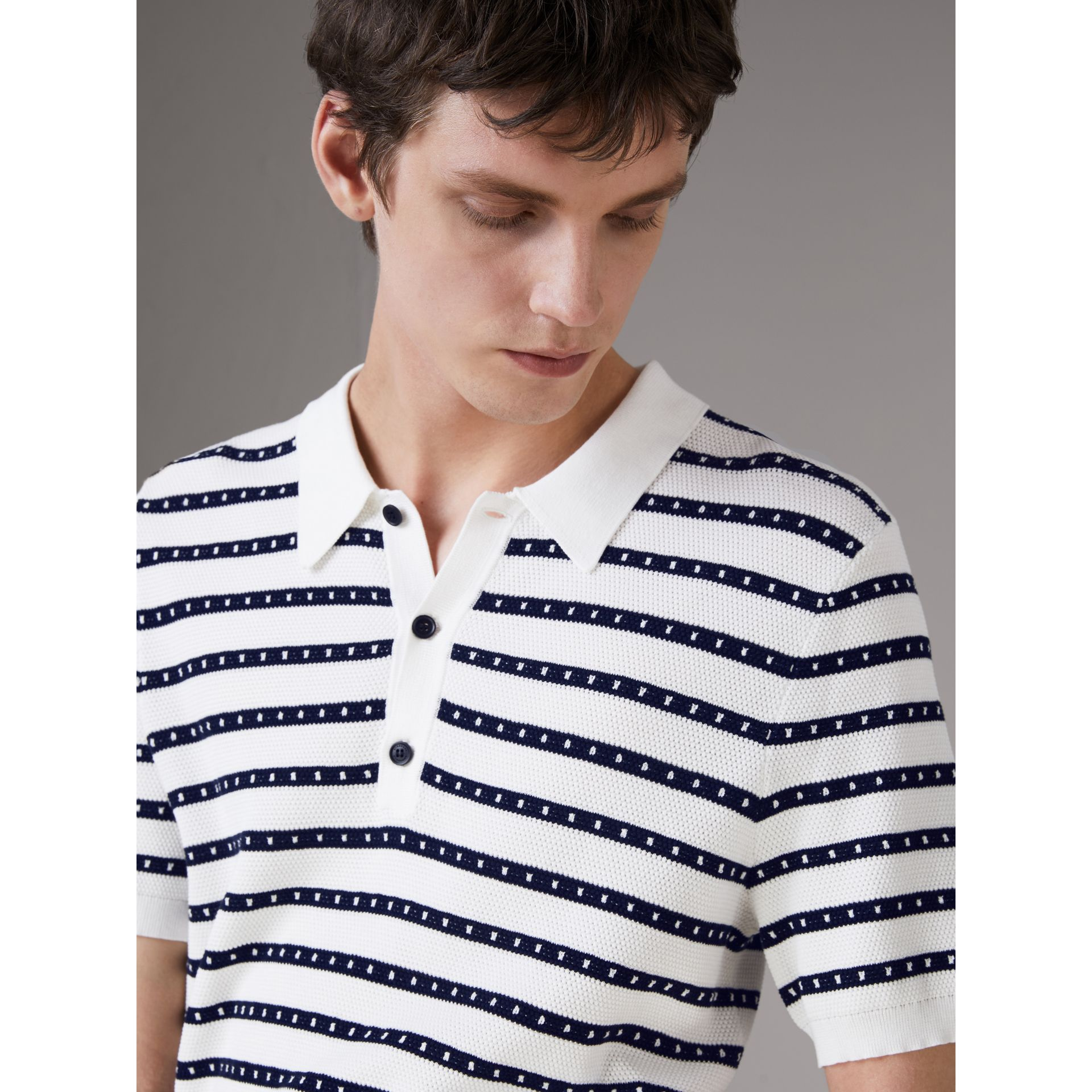 Striped Knitted Cotton Polo Shirt in Natural White - Men | Burberry - gallery image 1