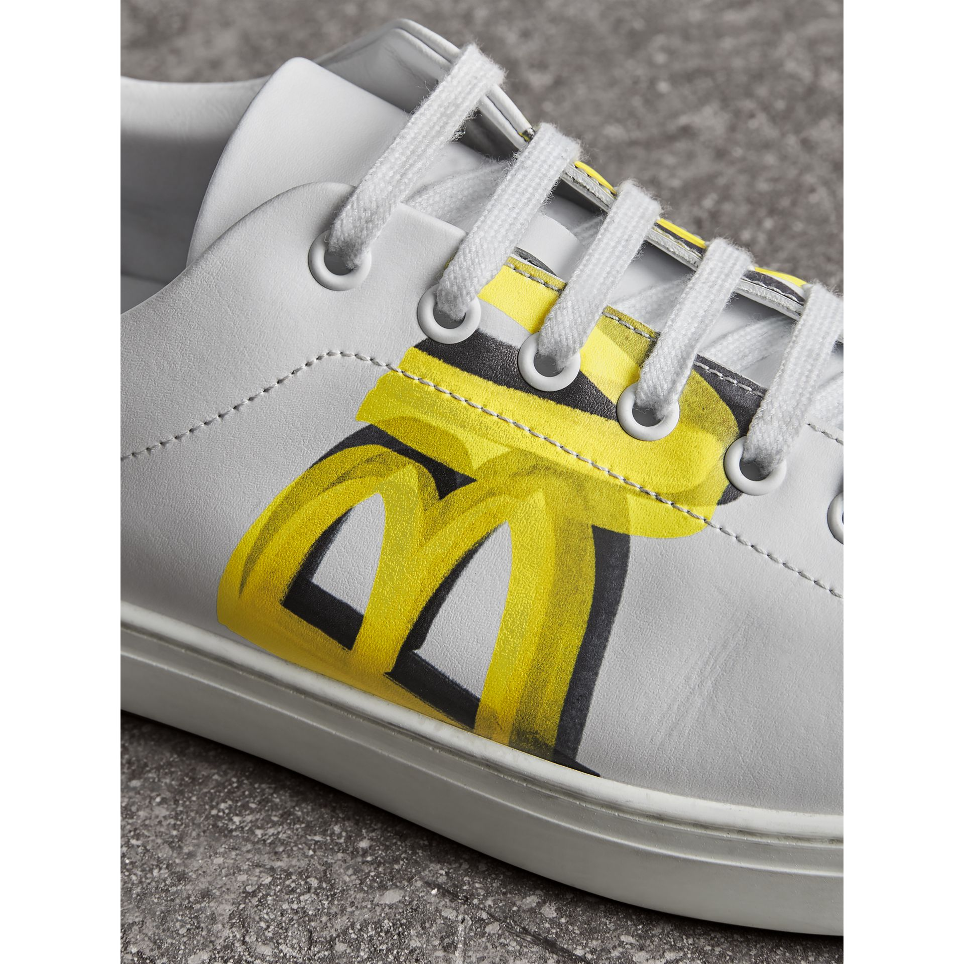 Logo Print Leather Sneakers in Optic White/yellow - Men | Burberry Australia - gallery image 1