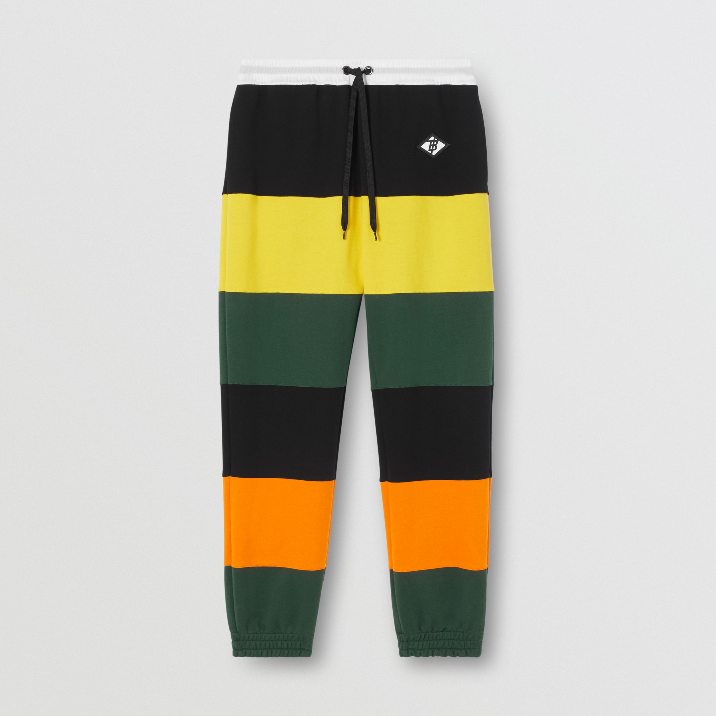 Logo Graphic Colour Block Cotton Trackpants in Canary Yellow - Men | Burberry - 4