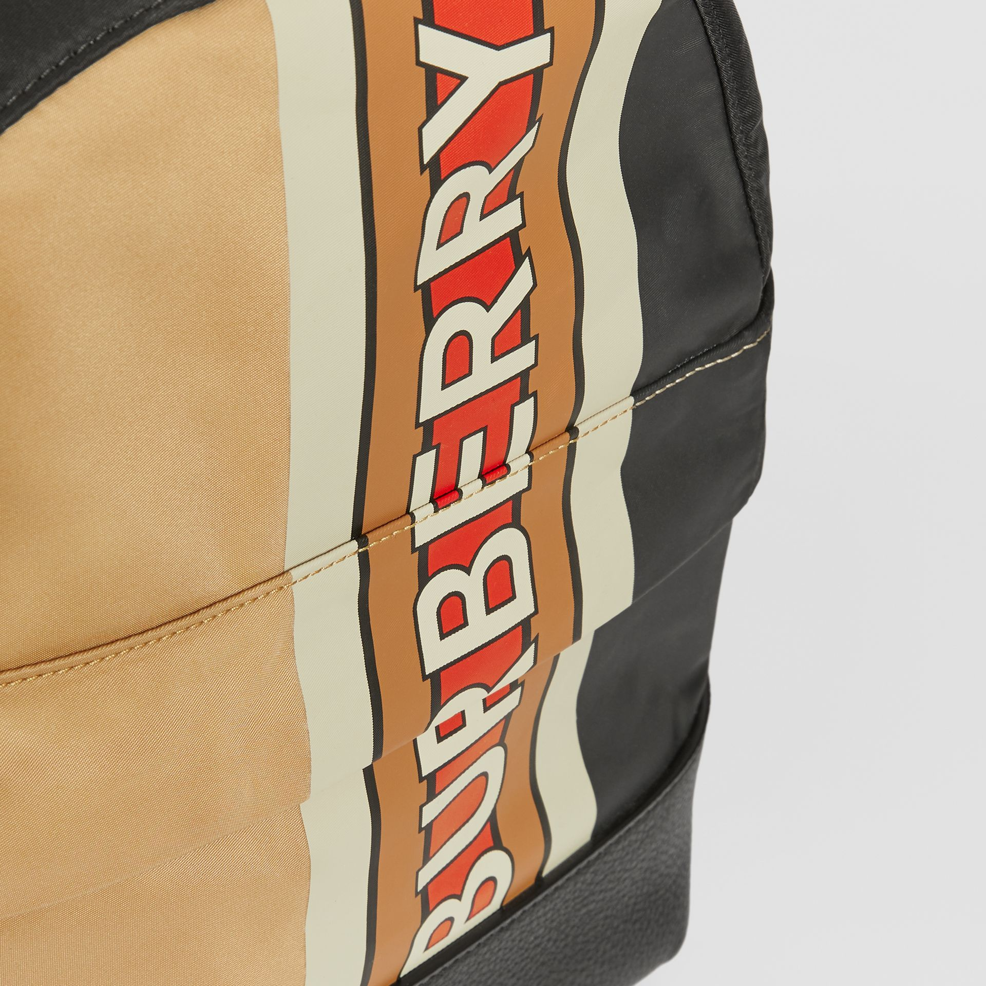 Logo Print Striped ECONYL® Backpack in Archive Beige - Children | Burberry United Kingdom - gallery image 1