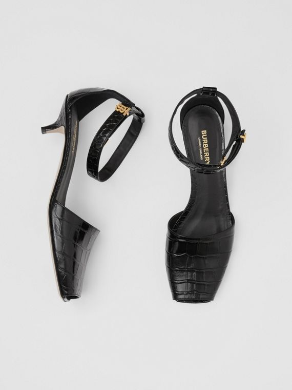 Monogram Motif Embossed Leather Sandals in Black