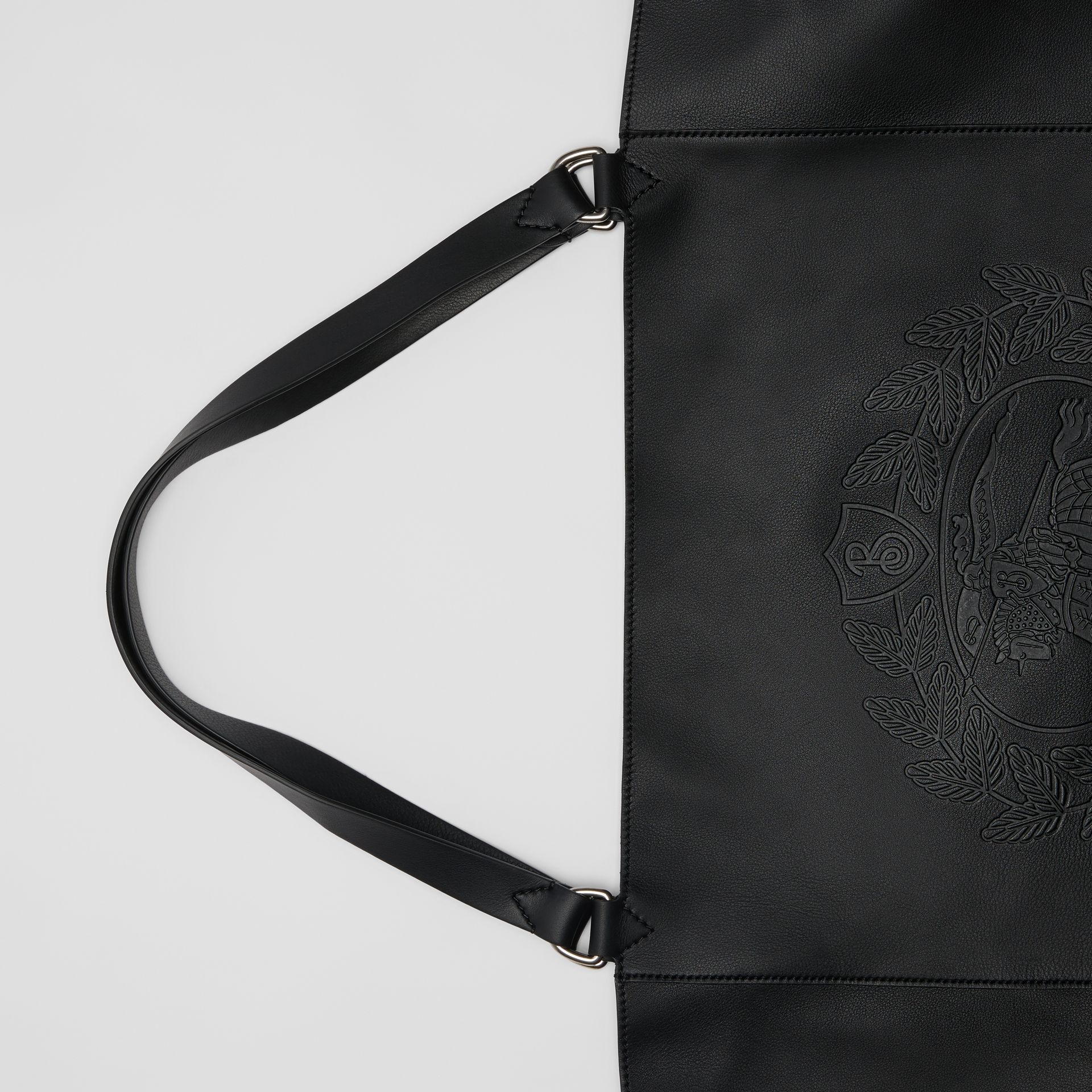 Large Embossed Crest Bonded Leather Tote in Black - Men | Burberry - gallery image 1