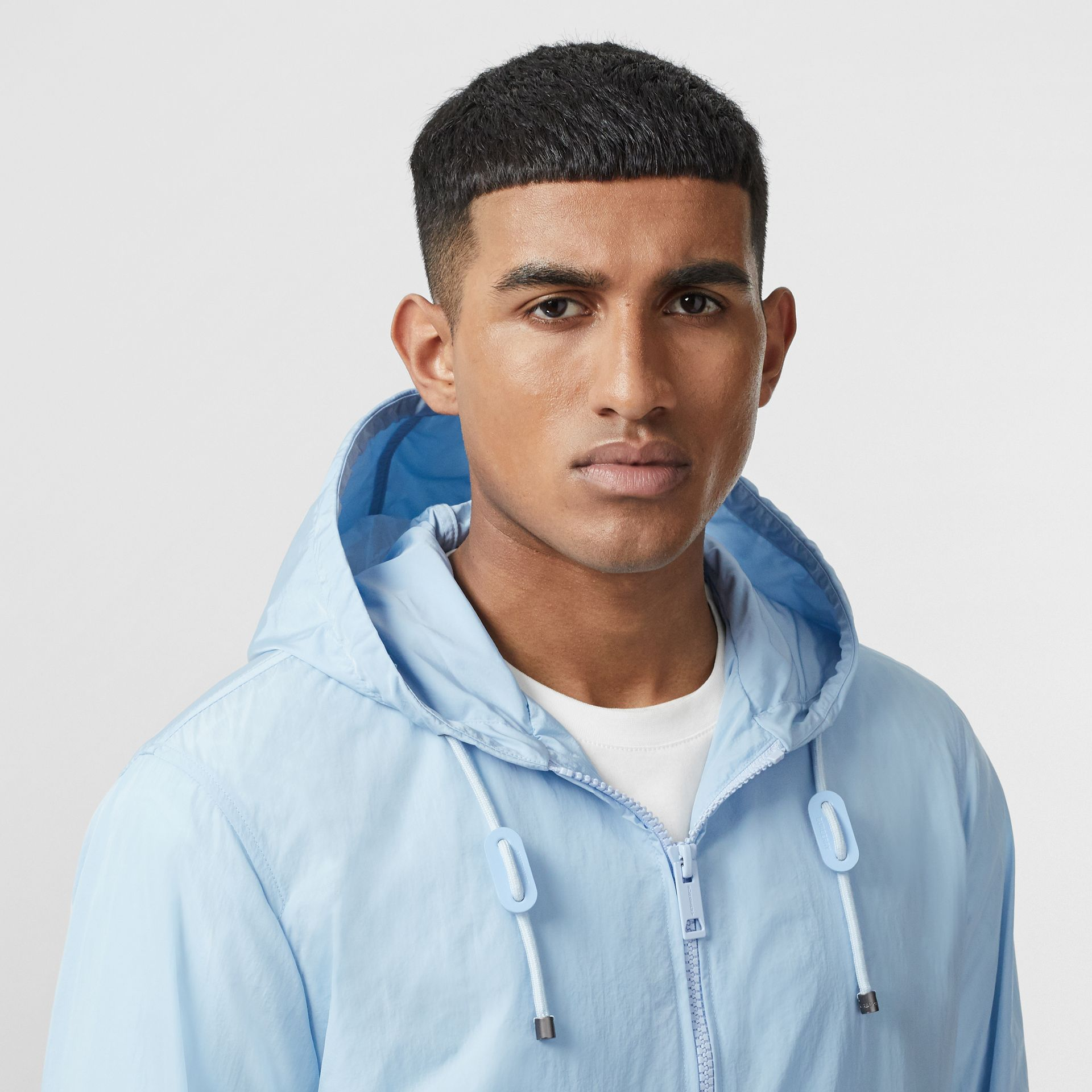 Packaway Lightweight Hooded Jacket in Pale Blue - Men | Burberry - gallery image 1