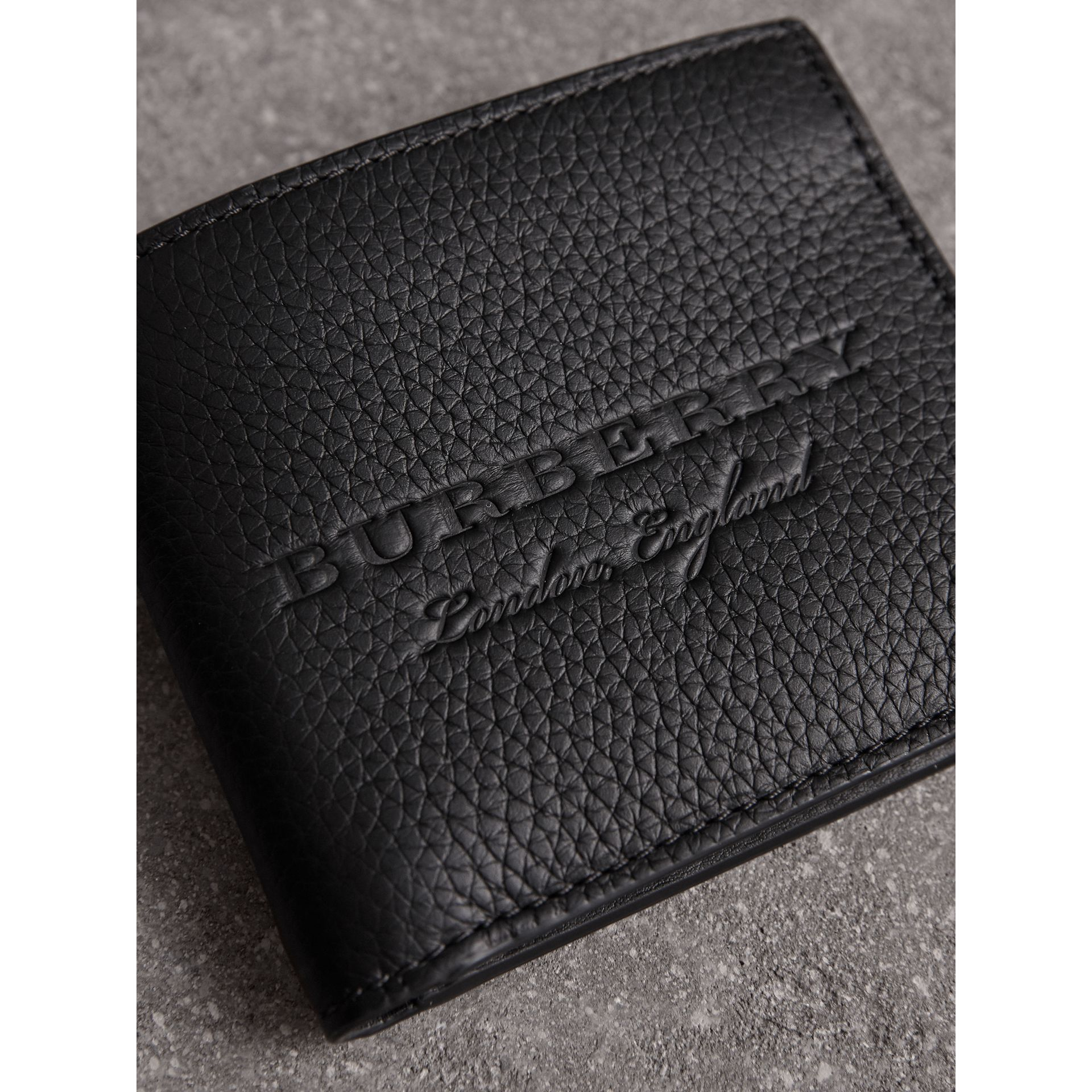 Embossed Leather Bifold Wallet in Black - Men | Burberry Canada - gallery image 1