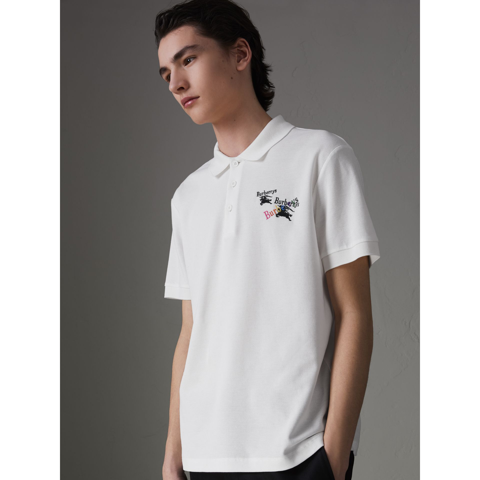 Triple Archive Logo Cotton Piqué Polo Shirt in White - Men | Burberry United Kingdom - gallery image 0