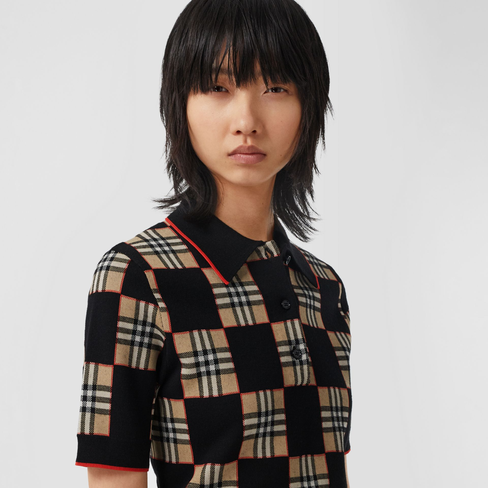 Chequer Merino Wool Blend Jacquard Polo Shirt in Black/archive Beige - Women | Burberry Hong Kong S.A.R - gallery image 1