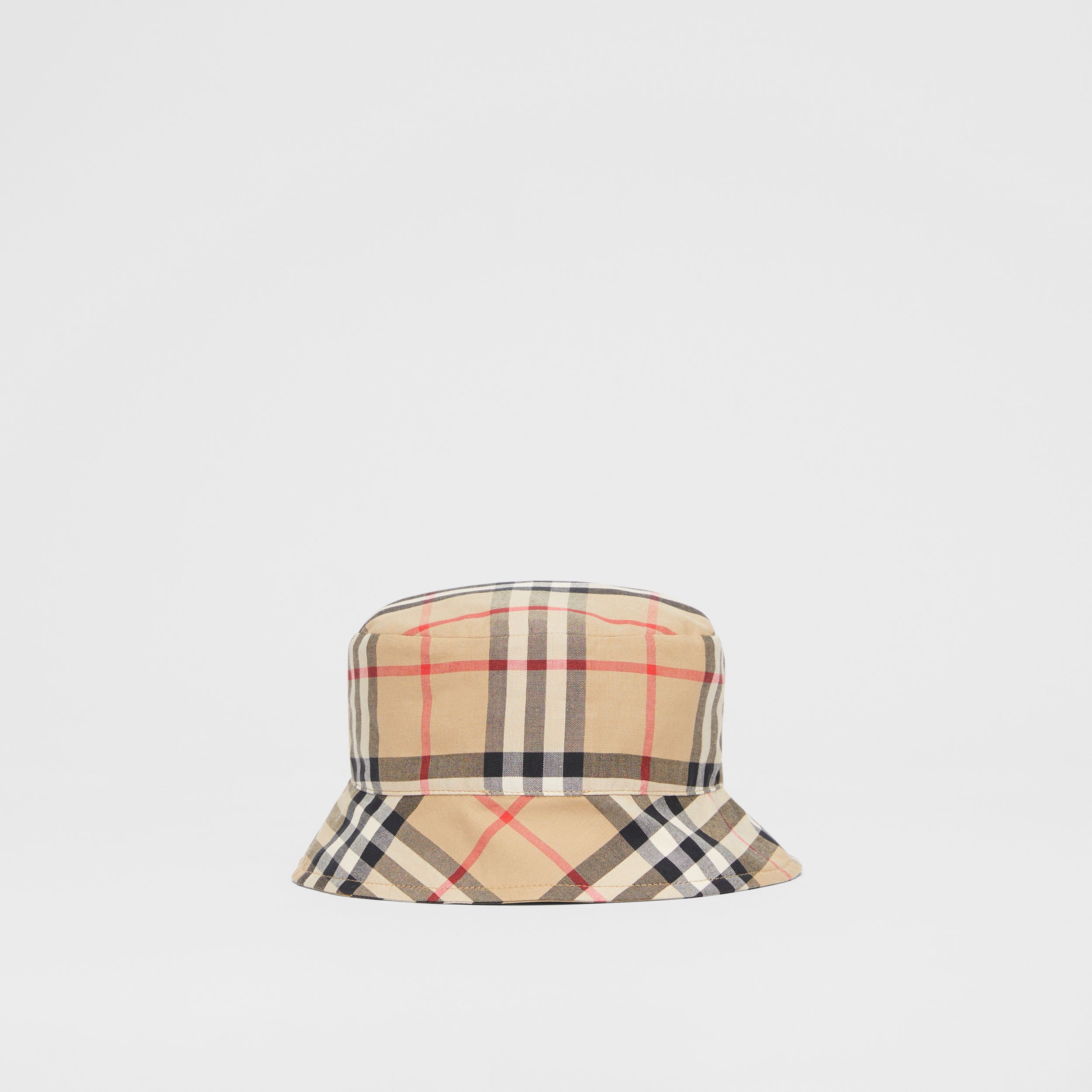 Reversible Vintage Check and Icon Stripe Bucket Hat in Archive Beige - Children | Burberry - 1