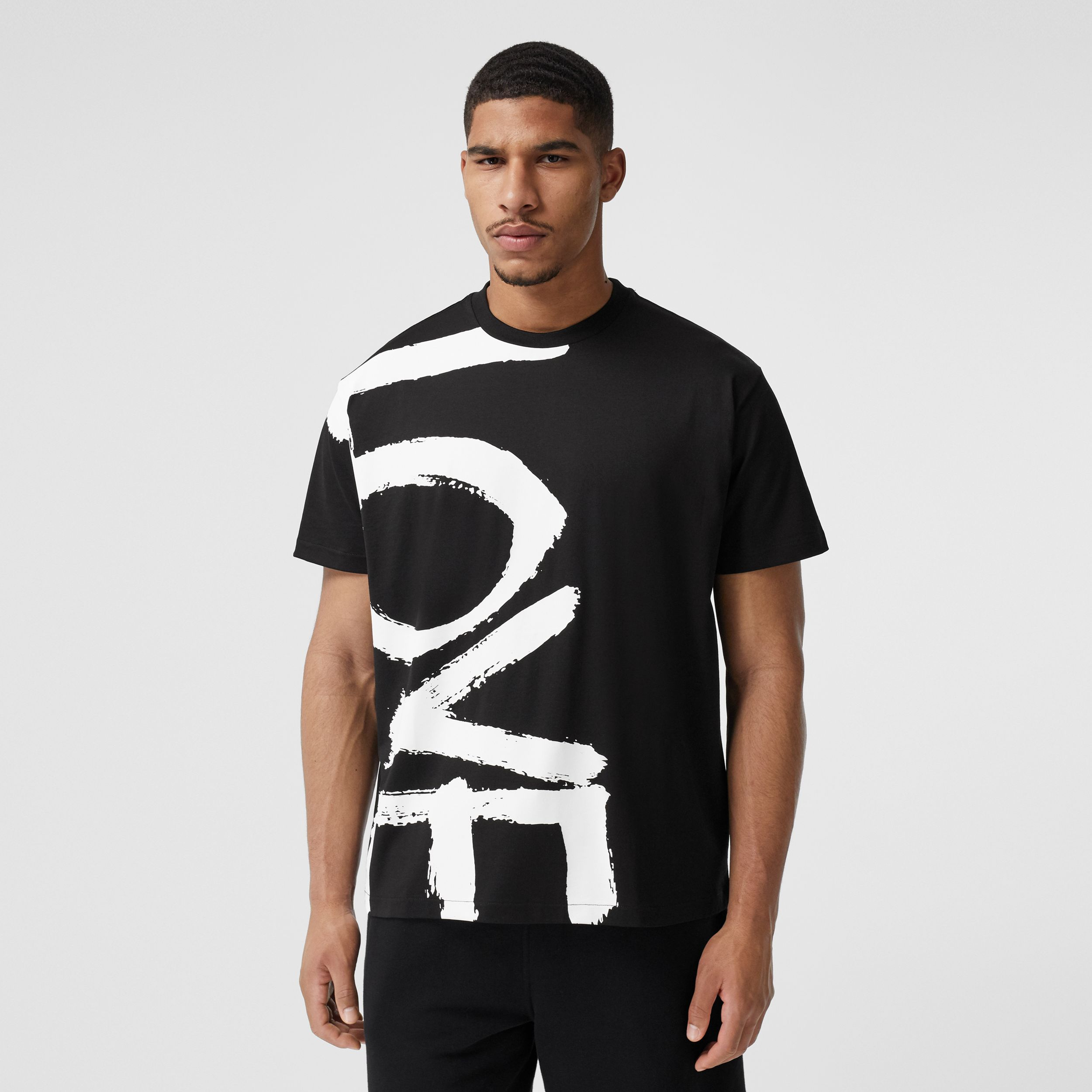 Love Print Cotton Oversized T-shirt in Black - Men | Burberry - 1