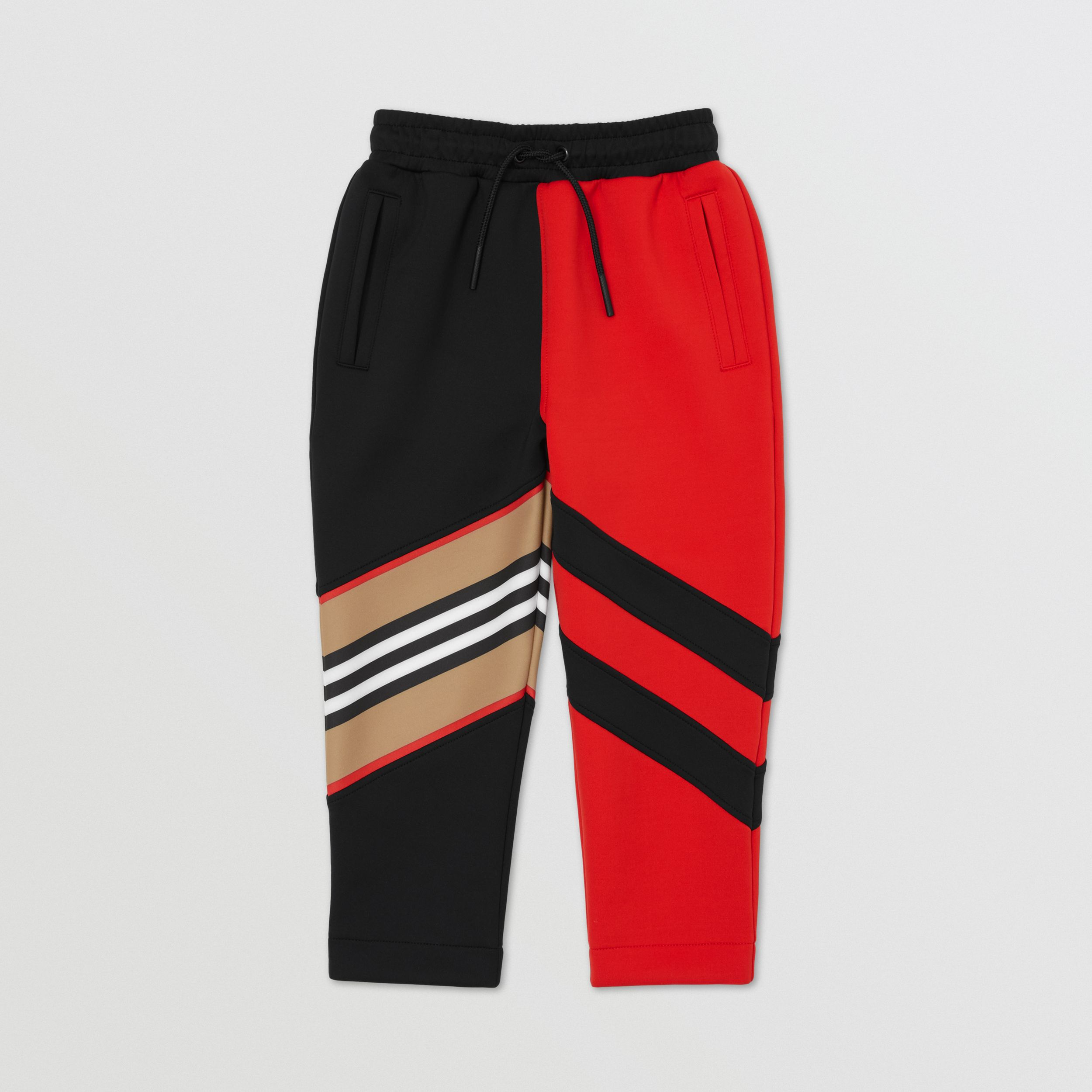 Pantaloni da jogging in jersey stretch con inserti con iconico motivo a righe (Rosso Intenso) | Burberry - 1