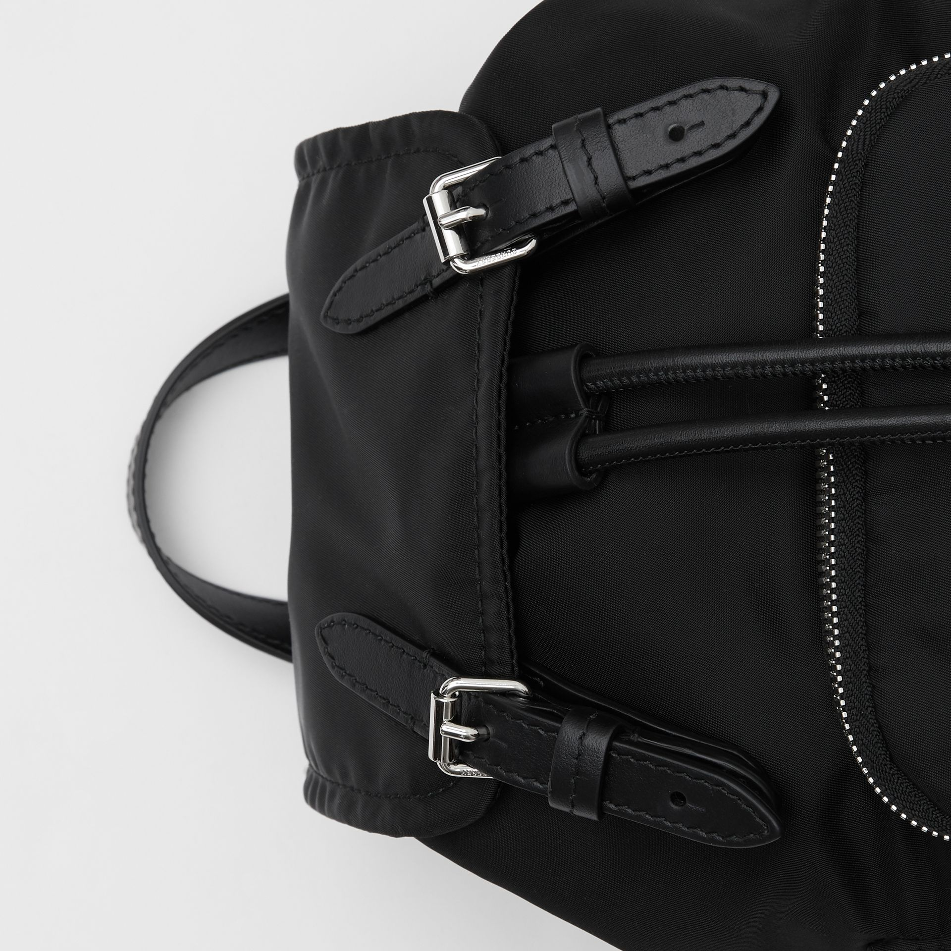The Small Rucksack in Logo Print ECONYL® in Black - Women | Burberry Canada - gallery image 1