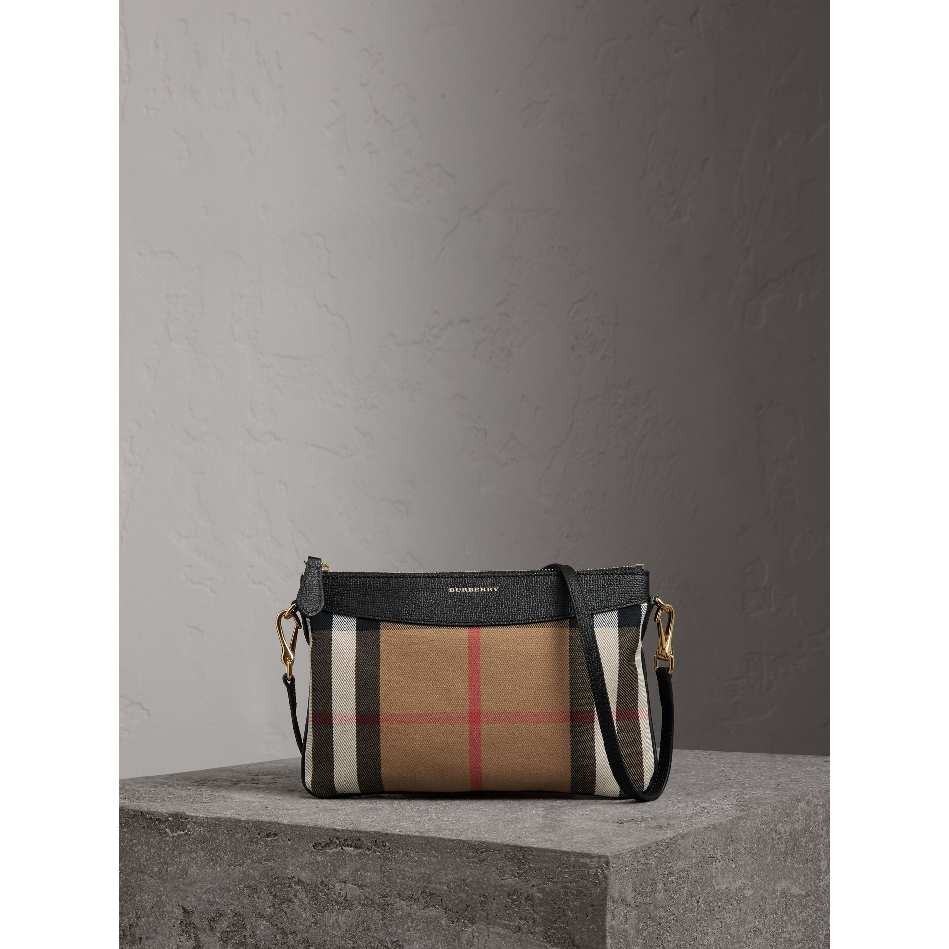 House Check and Leather Clutch Bag in Black - Women | Burberry - gallery image 1