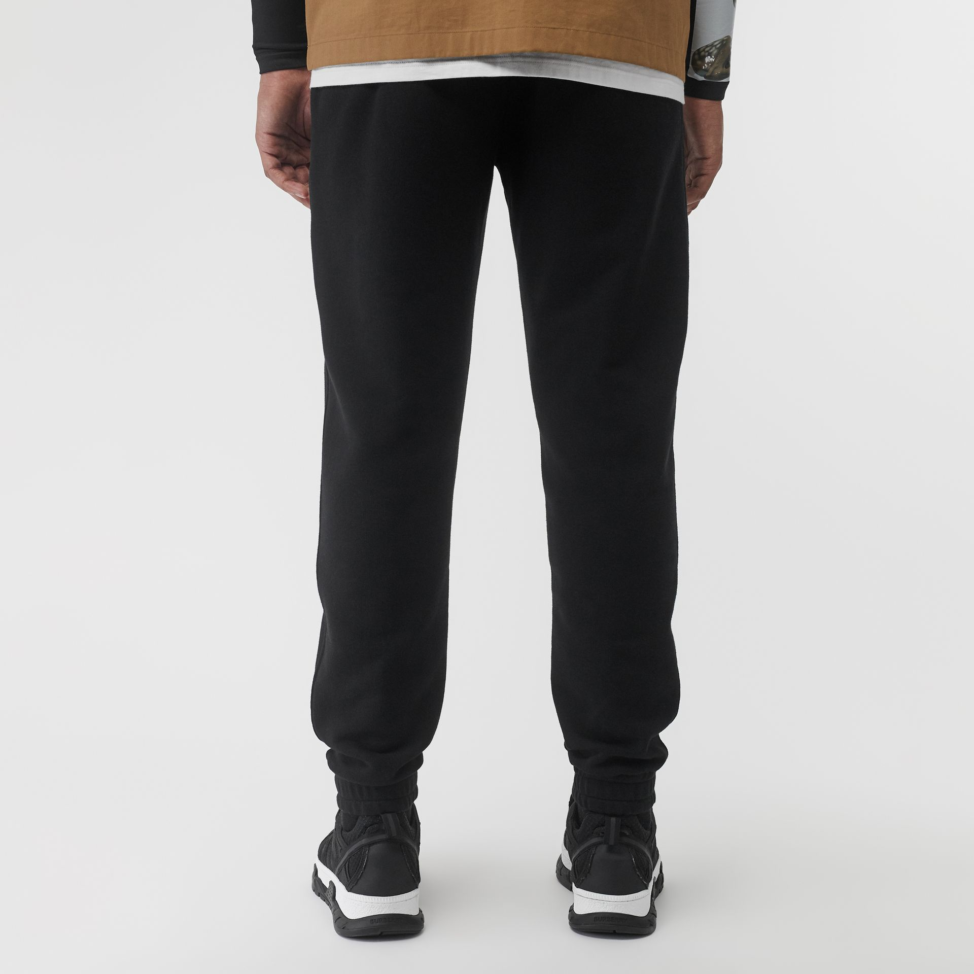 Logo Print Cotton Trackpants in Black - Men | Burberry - gallery image 2