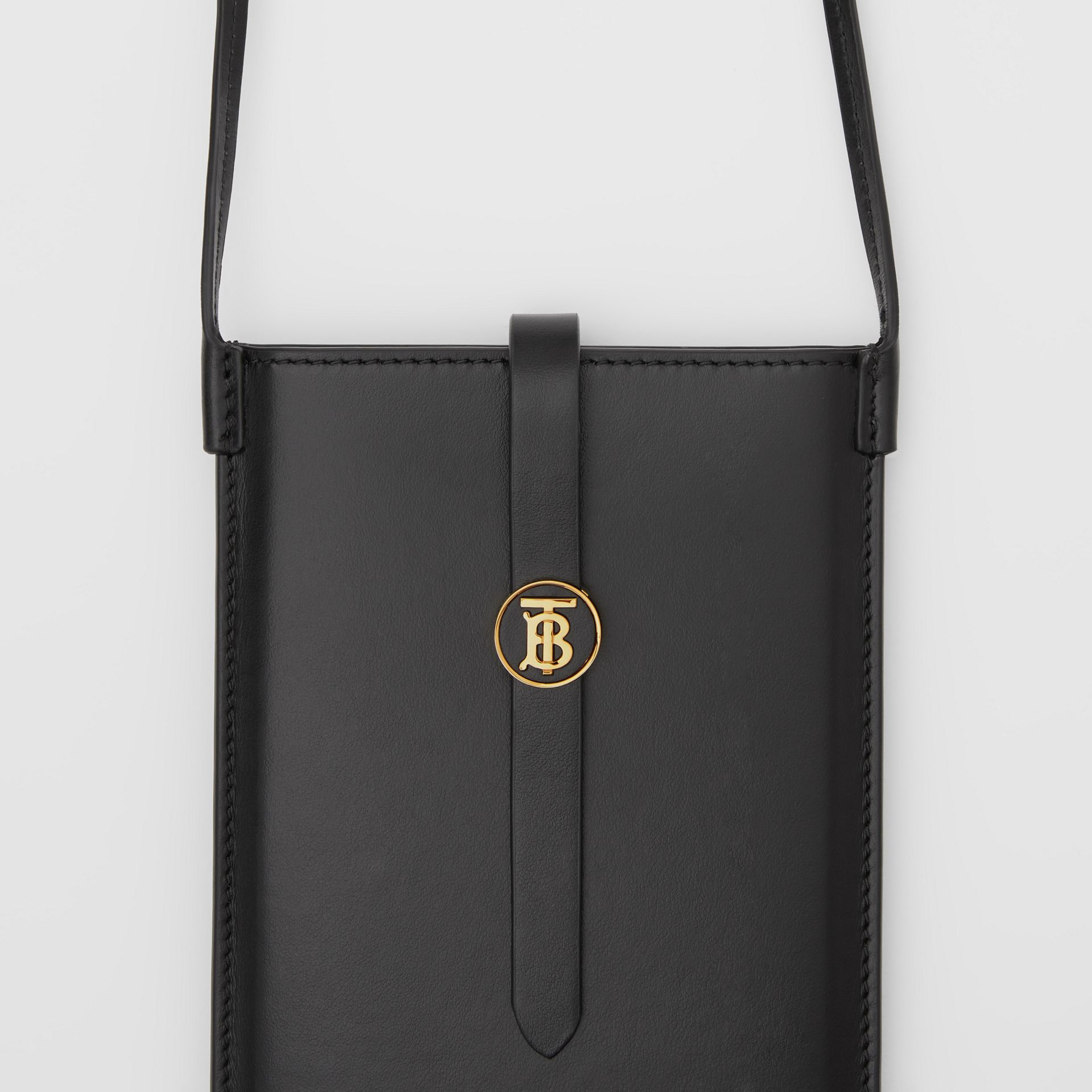Leather Phone Case with Strap in Black | Burberry - gallery image 1