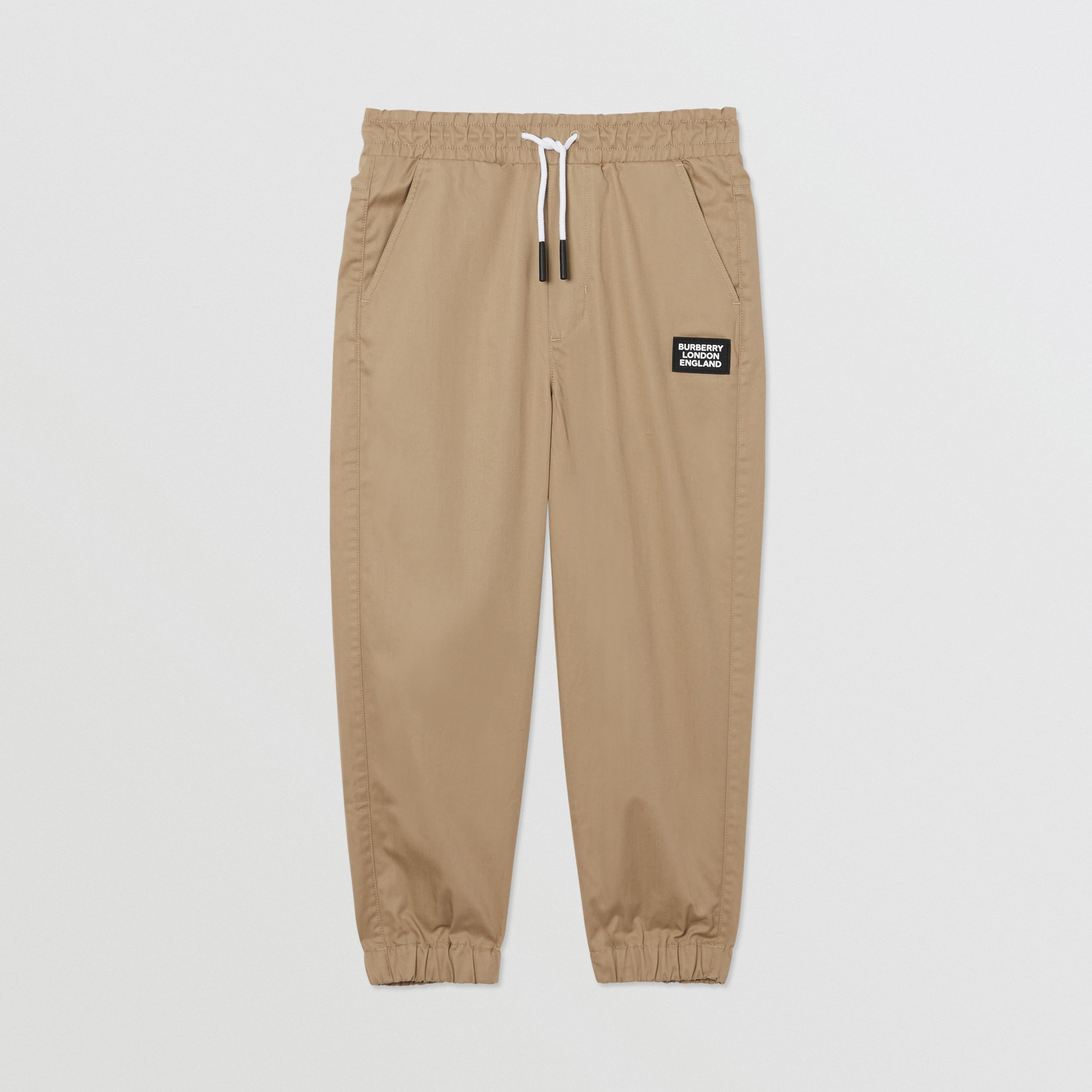 Logo Appliqué Cotton Twill Trackpants in Honey | Burberry - 1