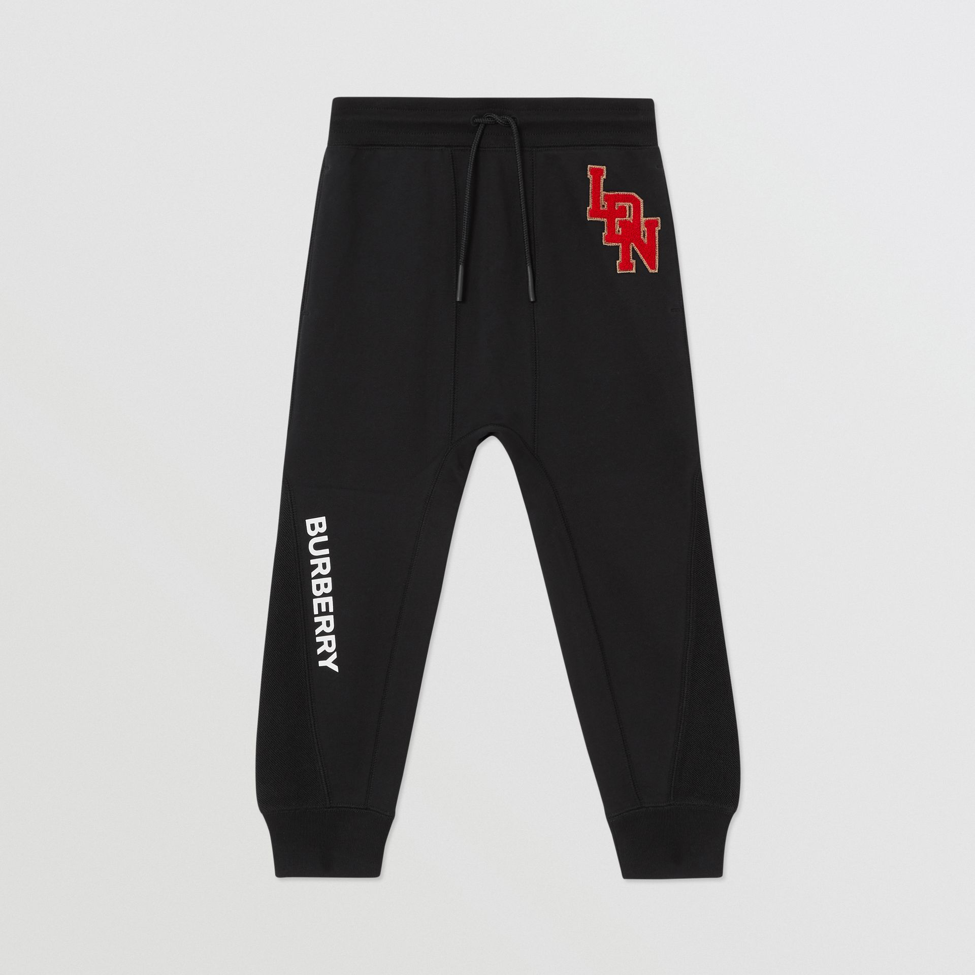 Logo Graphic Cotton Trackpants in Black | Burberry - gallery image 0