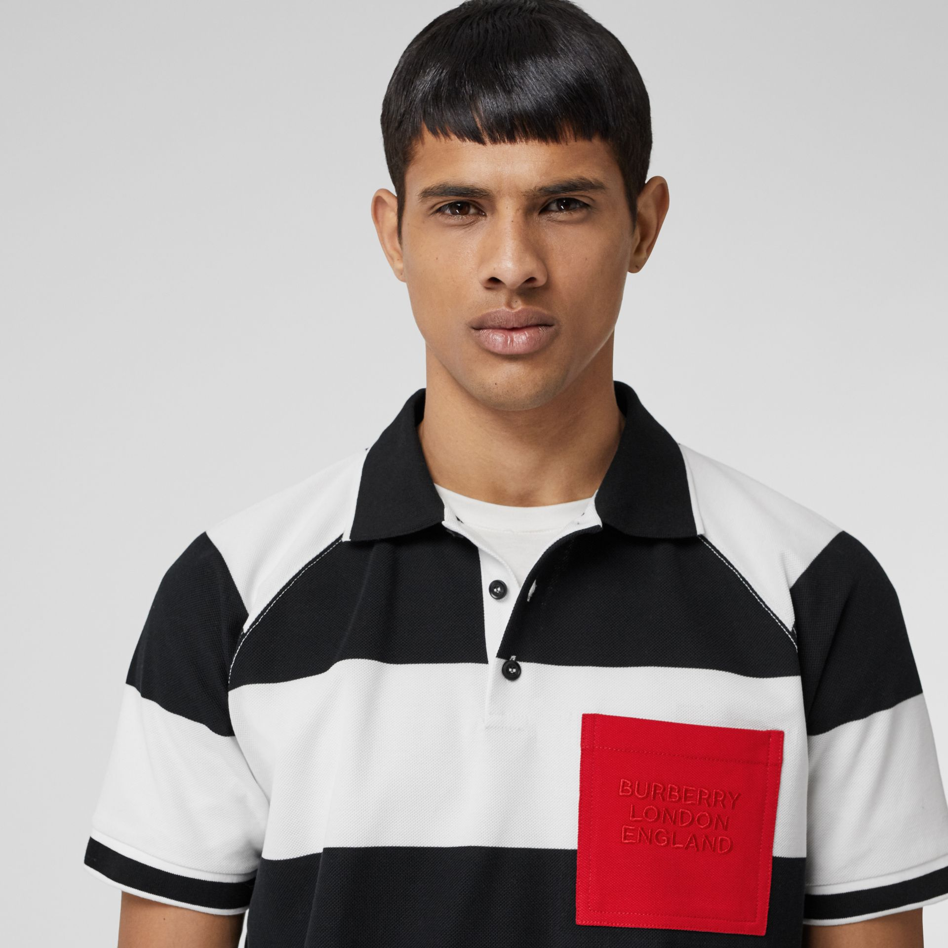 Rugby Stripe Tipped Cotton Piqué Oversized Polo Shirt in Black/white - Men | Burberry United Kingdom - gallery image 1