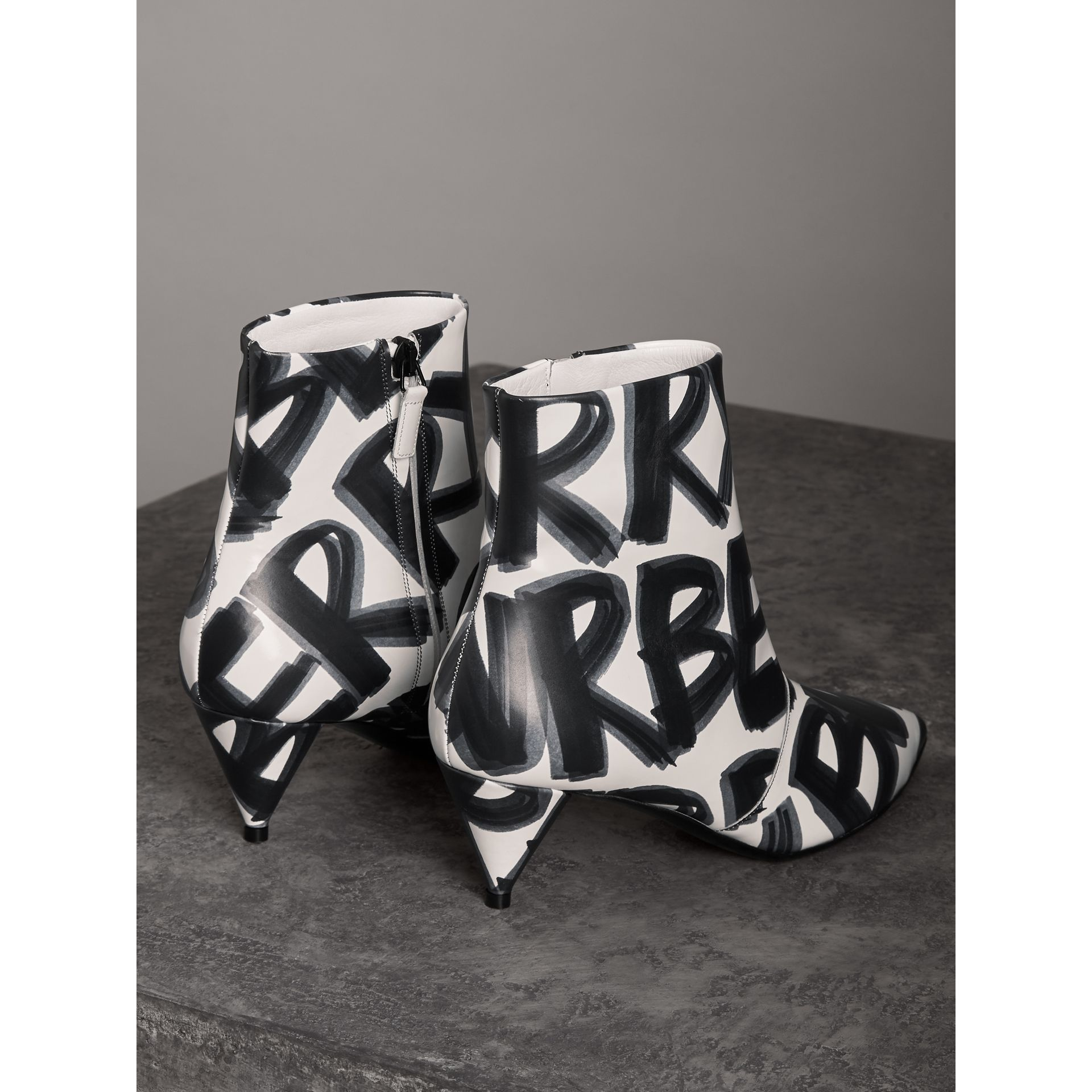 Graffiti Print Leather Ankle Boots in Optic White - Women | Burberry - gallery image 3